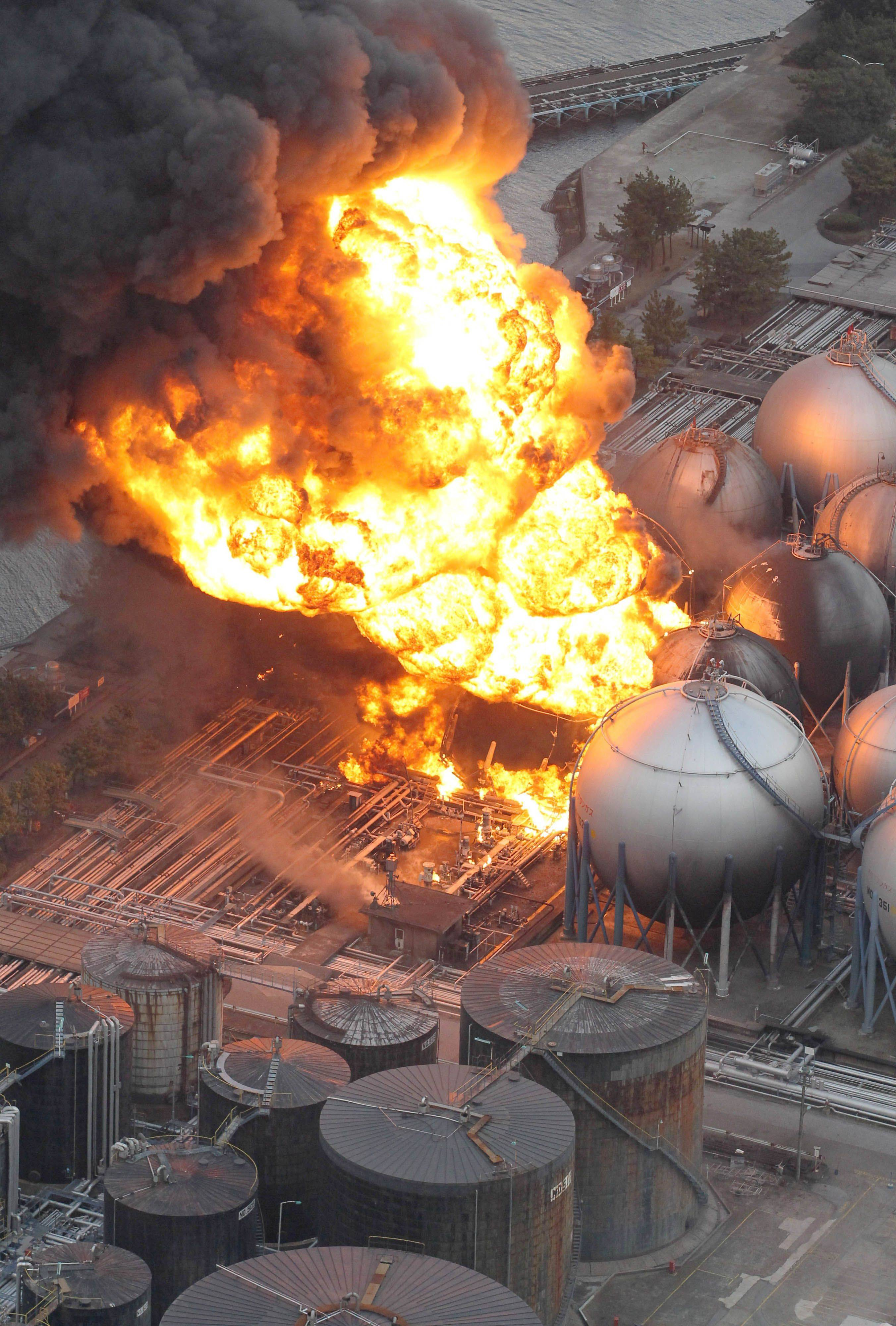 Giant fireballs rise from a burning oil refinery in Ichihara, Chiba Prefecture (state) after Japan was struck by a strong earthquake off its northeastern coast Friday.