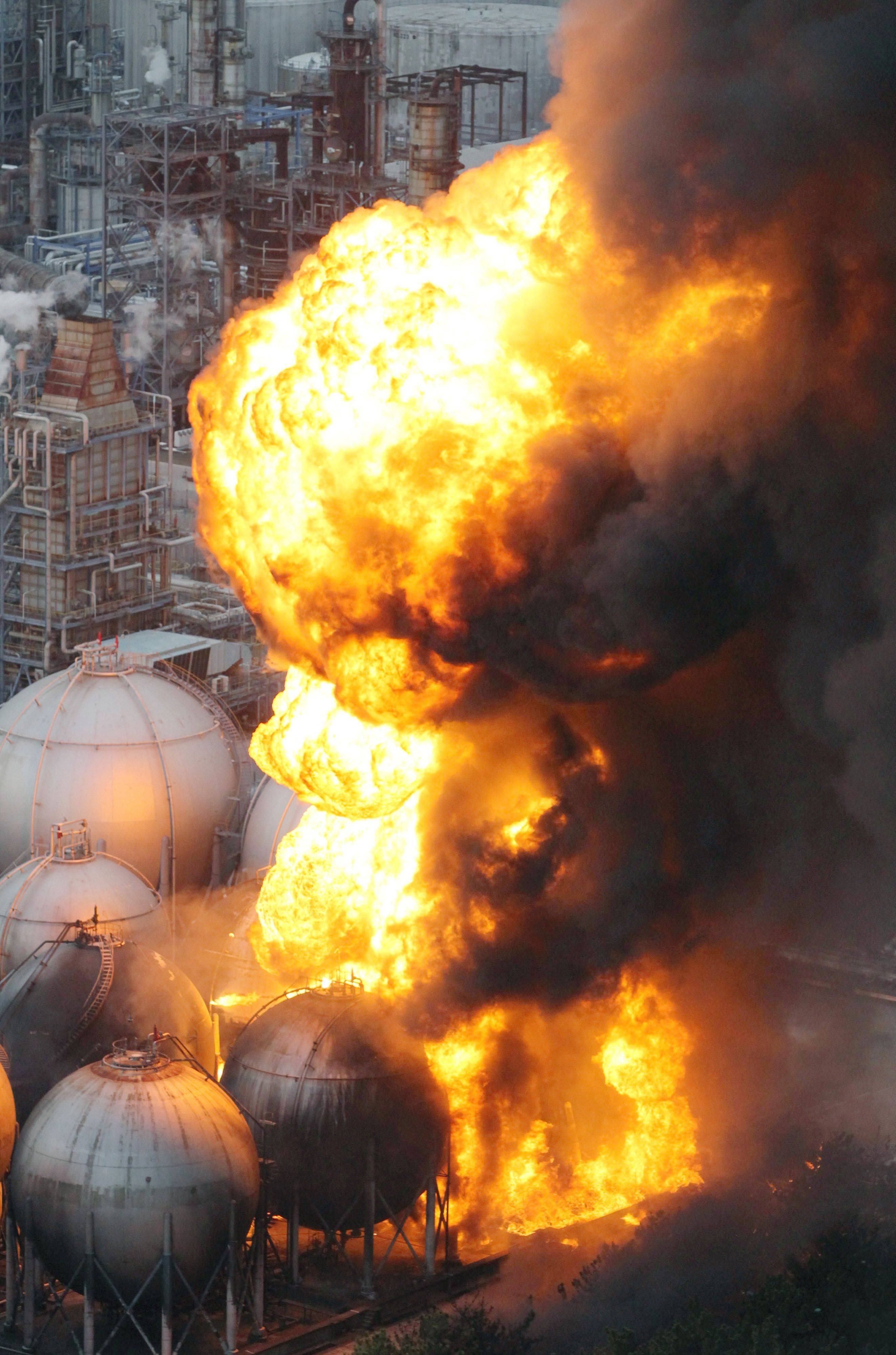Giant fireballs rise from a burning oil refinery in Ichihara, Chiba Prefecture (state) after Japan was struck by a strong earthquake.