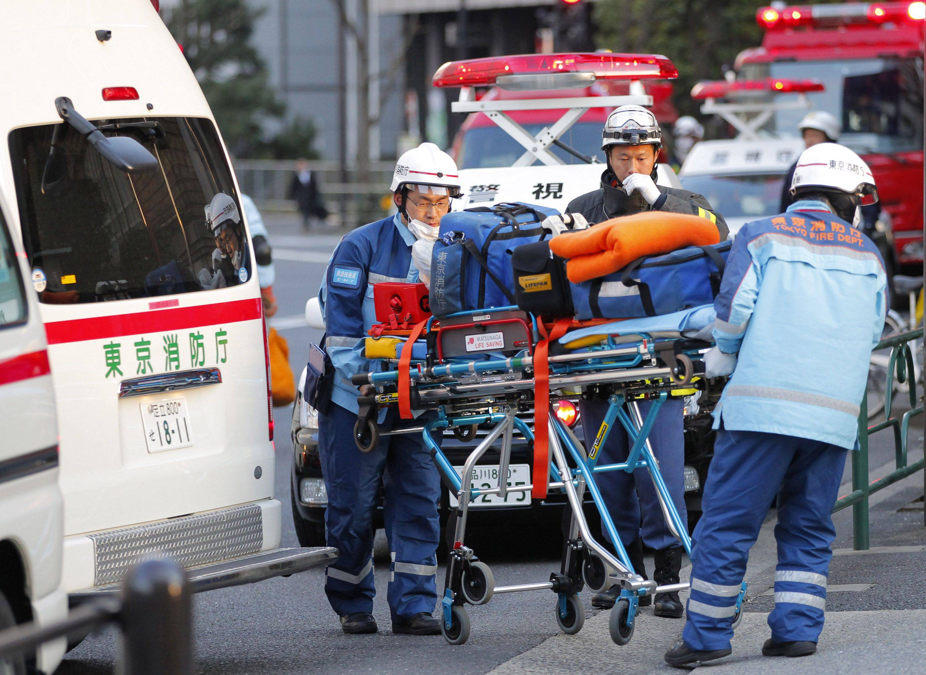 Tokyo Fire Department rescue workers arrive at Kudan Kaikan in Tokyo as local media said its ceiling was damaged after a strong earthquake and injured people inside the hall Friday.