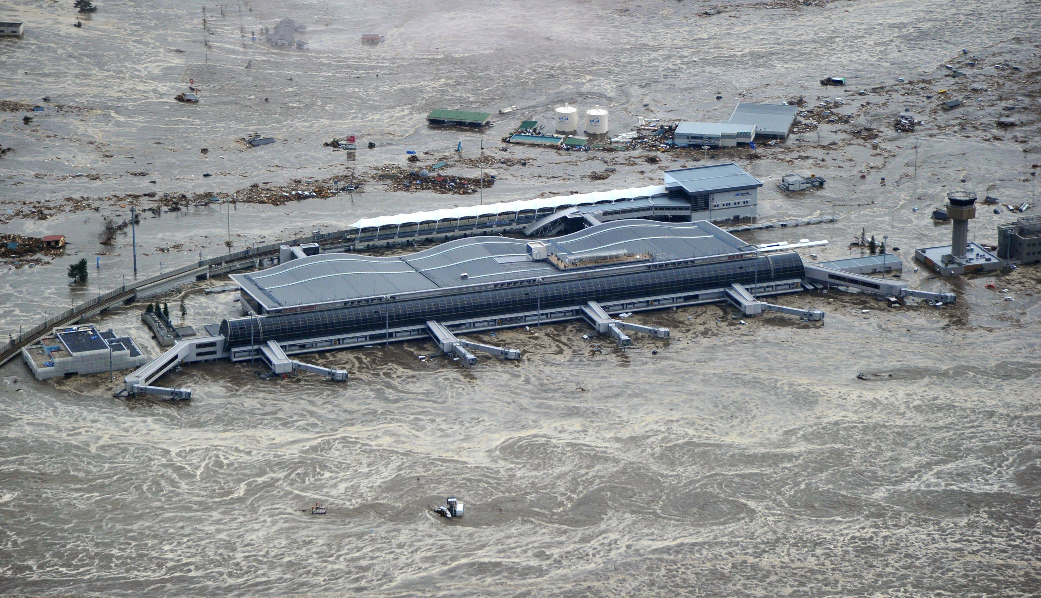 Sendai Airport is surrounded by waters in Miyagi prefecture (state), Japan, after a ferocious tsunami spawned by one of the largest earthquakes ever recorded slammed Japan's eastern coast Friday.