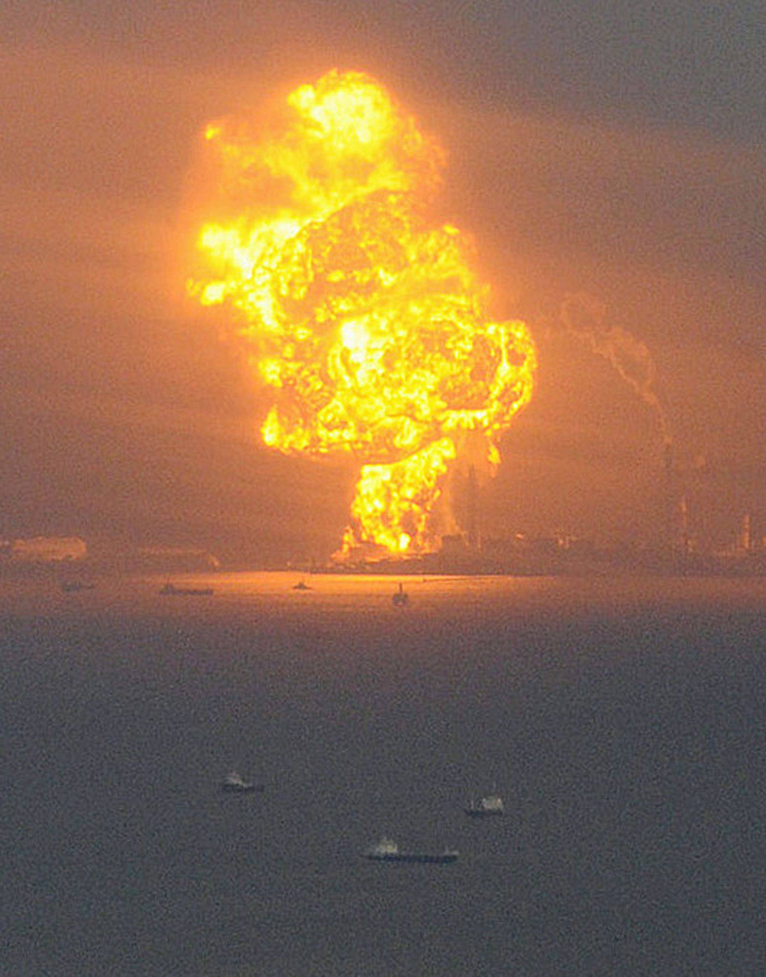 Flames rise from an oil refinery after a powerful earthquake in Ichihara, Chiba prefecture (state), Japan.