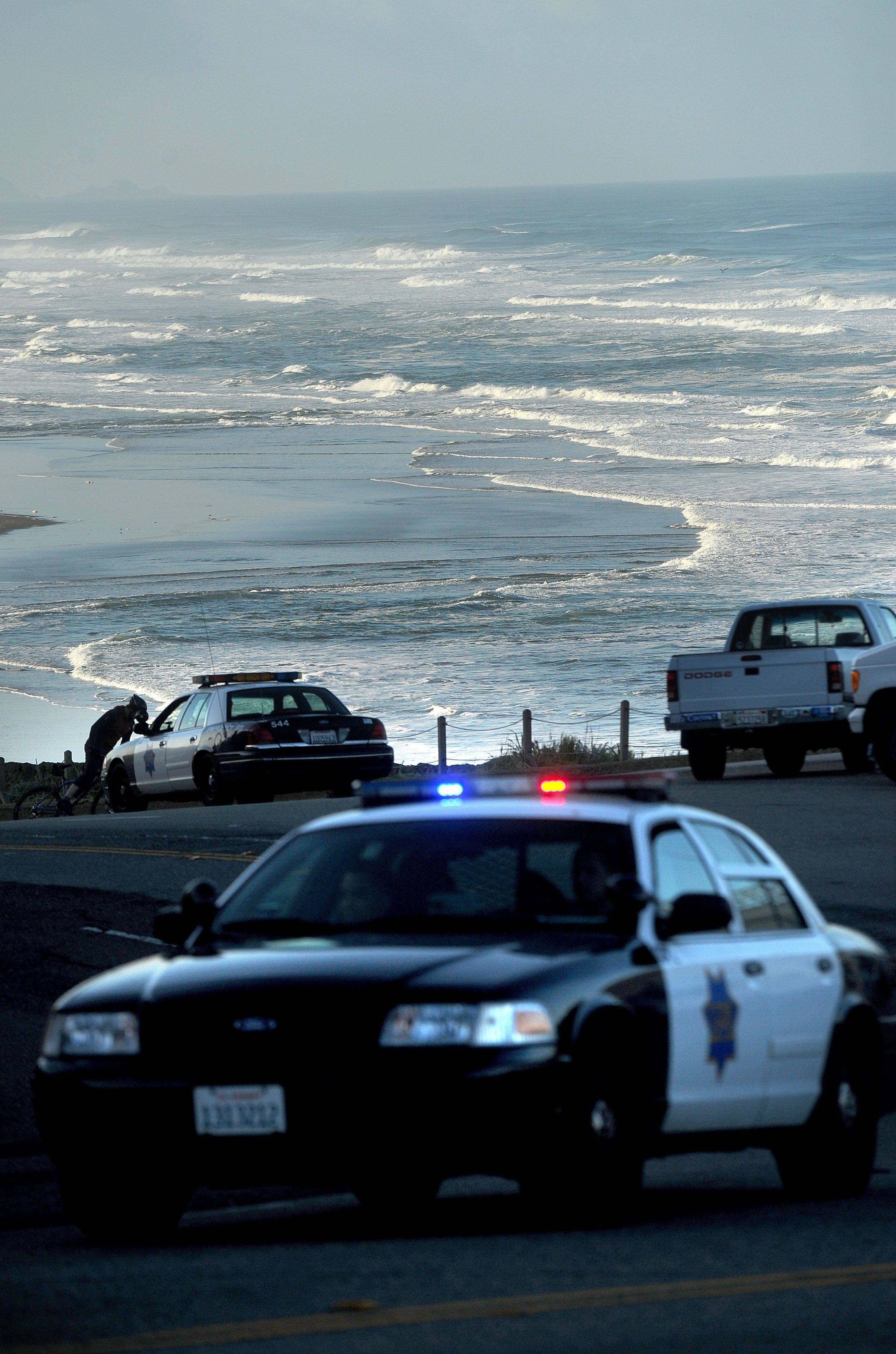With a tsunami warning in effect for Northern California, police patrol along San Francisco's Great Highway on Friday, March 11, 2011. Tsunami warnings were issued after an 8.9-magnitude earthquake struck Japan.