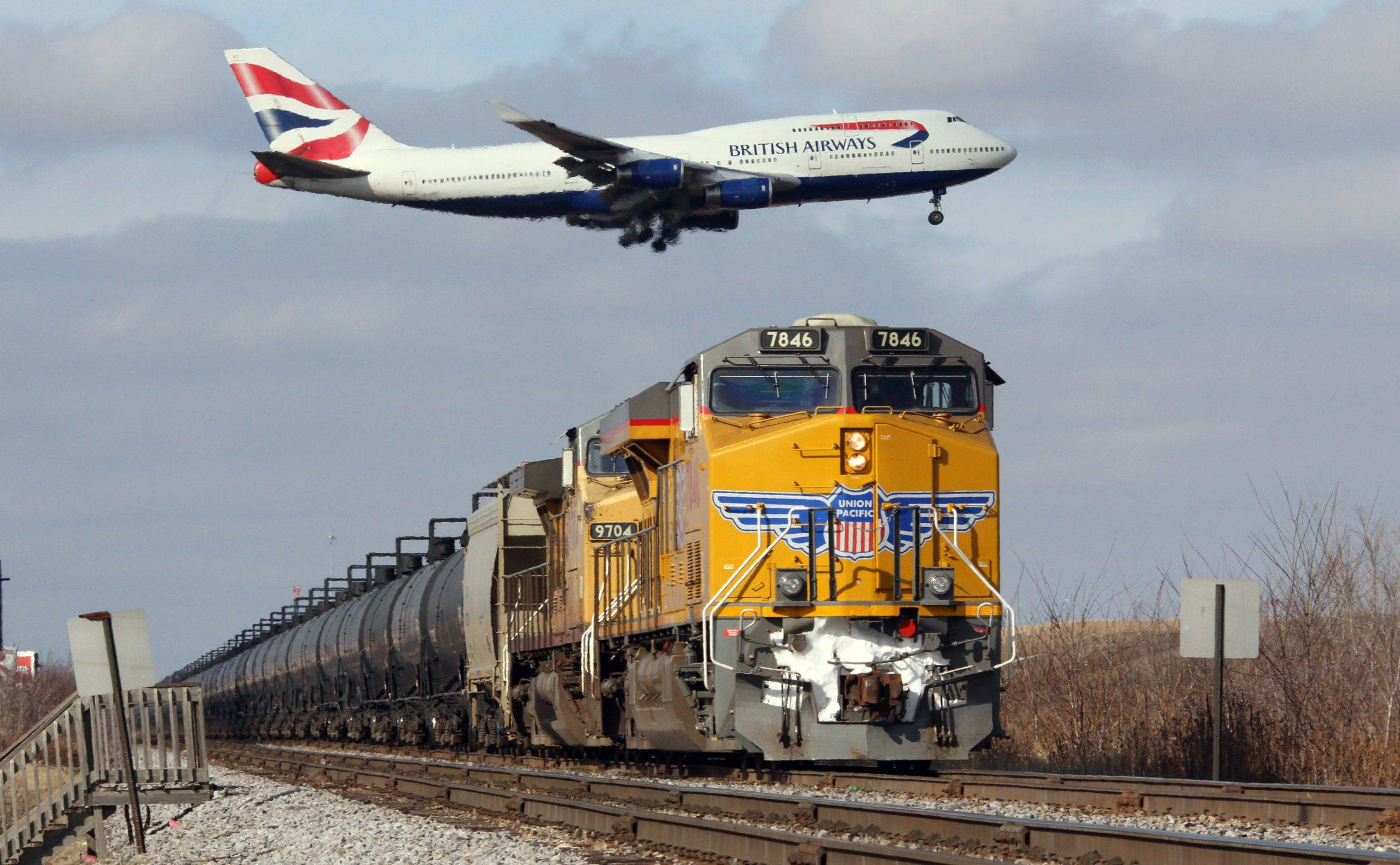 Larry Pearlman of NapervilleI took this photo of a British Airways Boeing 747 and a Union Pacific ethanol train yesterday in Bensenville, Illinois. The approach for the runway at O'Hare goes right over the Union Pacific railroad tracks. What makes this appear more extreme is the use of a very large (100-400) zoom lens. This is a great spot for plane spotters and train watchers alike.
