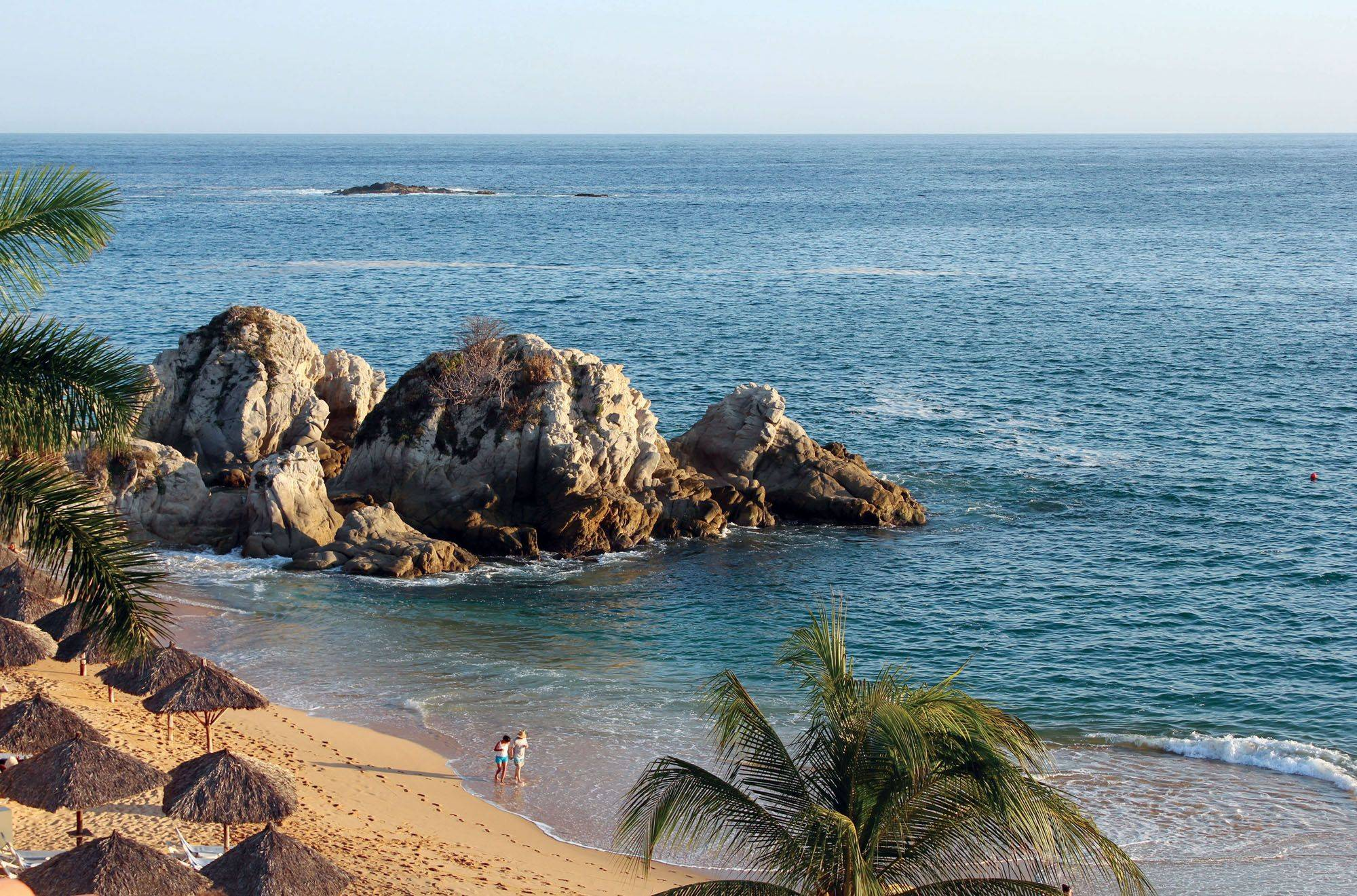Jeff Farinosi of Vernon HillsA couple walks along the beach in Tangolunda Bay, Huatulco.