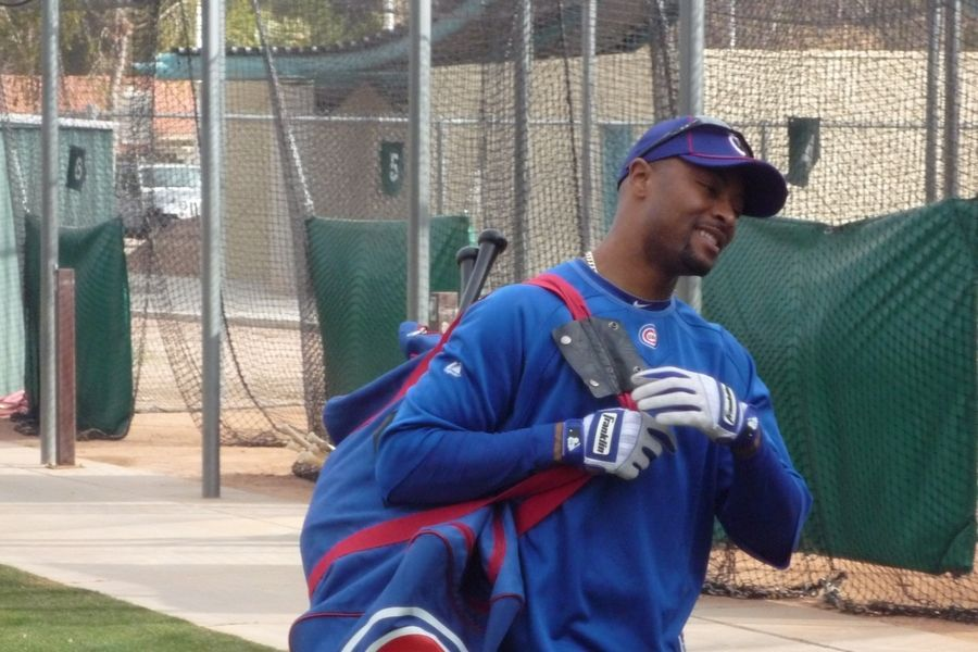 Bruce Miles/bmiles@dailyherald.com ¬ He's been to plenty of spring trainings, and veteran Bobby Scales is all smiles as he gets down to work Saturday at Cubs spring training in Mesa, Ariz. ¬