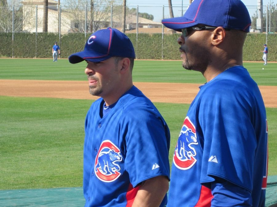 Bruce Miles/bmiles@dailyherald.com ¬ Images from Cubs players and personnel at spring training in Mesa on Wednedsay. Augie Ojeda and Bobby Scales watch batting practice.