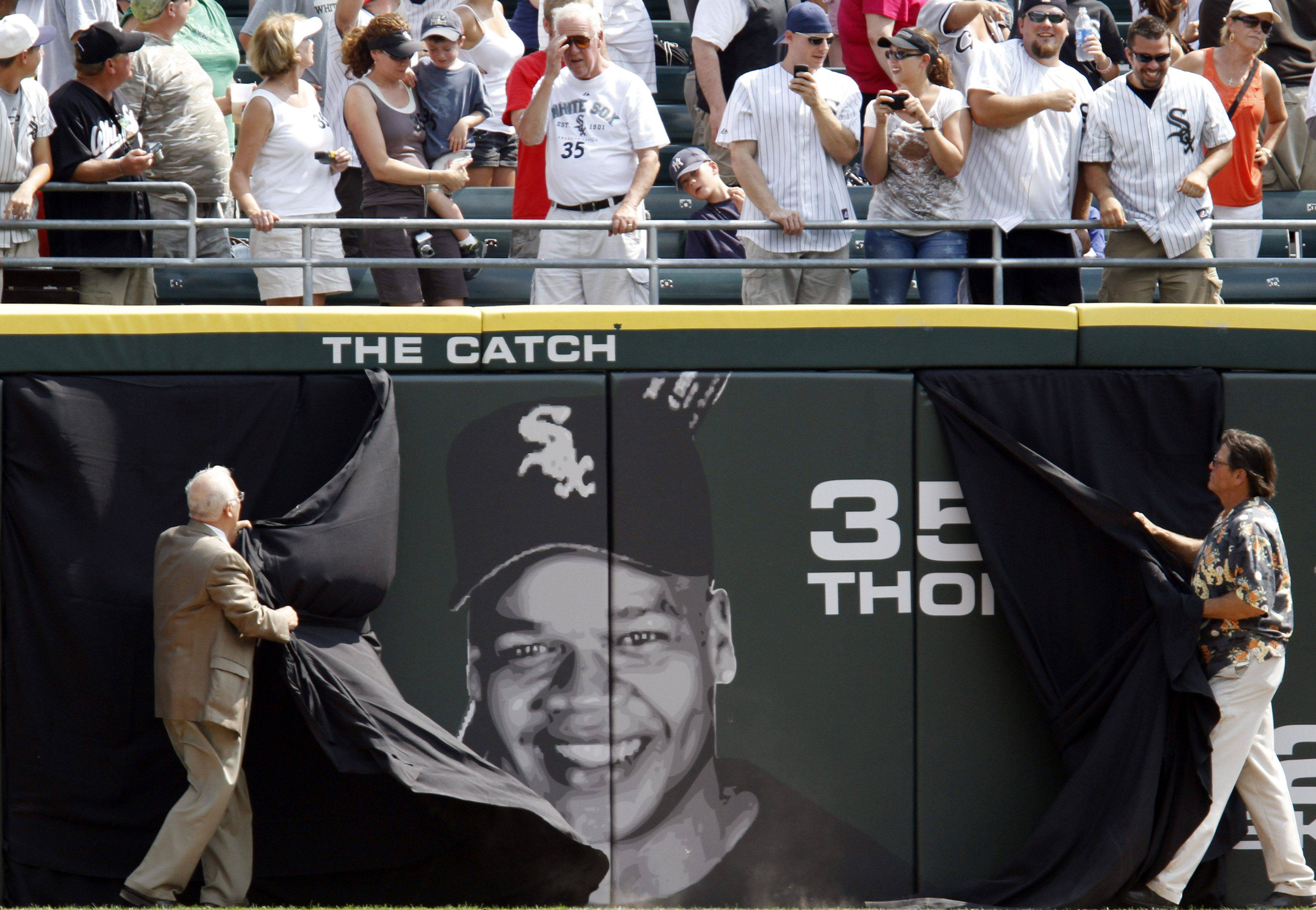 Former Chicago White Sox player Frank Thomas' face is unveiled on the outfield wall before a baseball game between the New York Yankees and the White Sox in Chicago, Sunday, Aug. 29, 2010. Thomas is the 10th White Sox player whose number has been retired and whose face appears on the outfield wall.