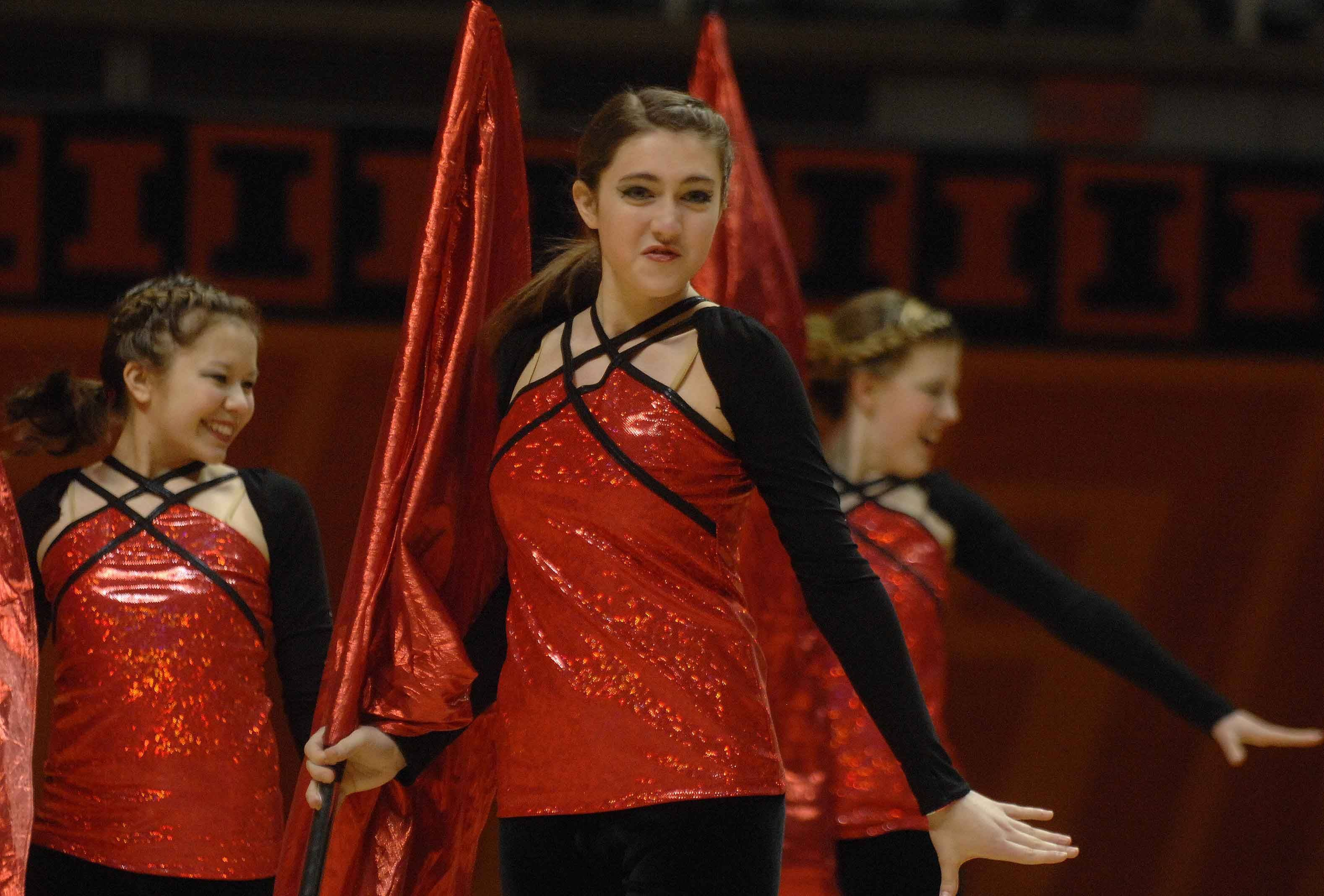 The Lake Zurich tall flag team takes part in the Illinois Drill Team Association State Finals in Champaign Saturday.