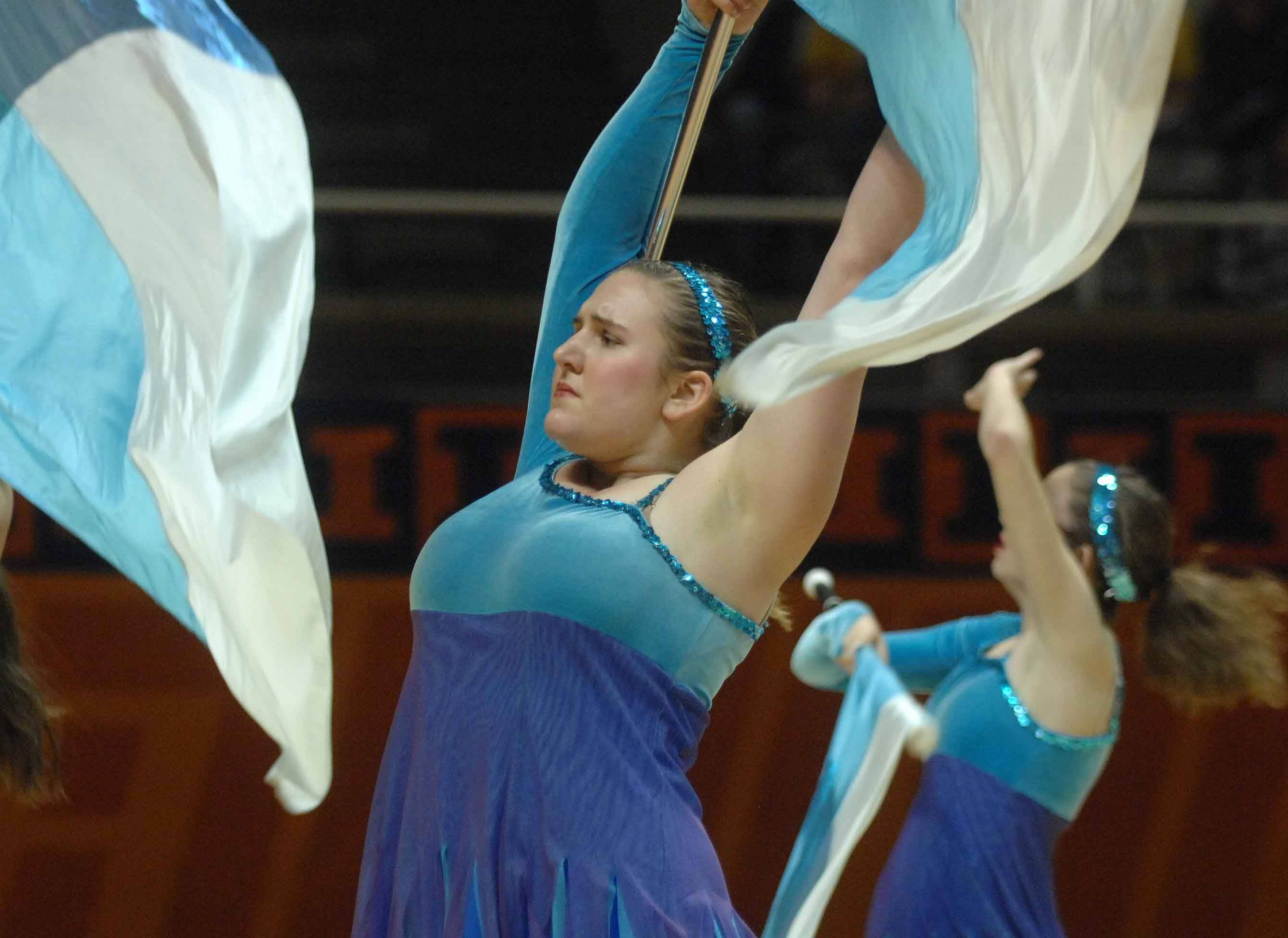 Maggie Benhart of St. Charles East takes part in the lyrical flag competition during the Illinois Drill Team Association State Finals in Champaign Saturday.