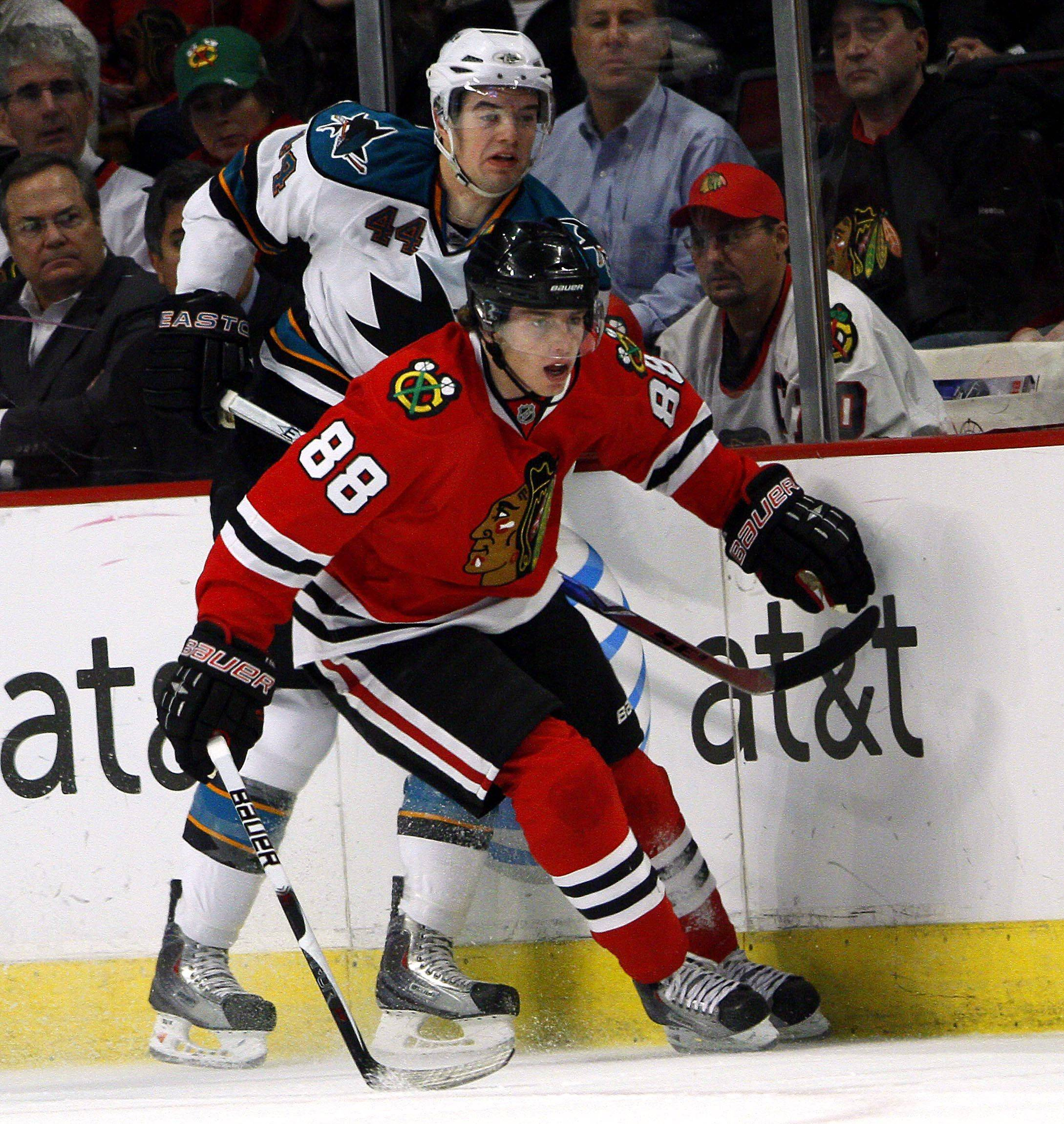 The Hawks' Patrick Kane, skating in front of San Jose's Marc-Edouard Vlasic in the first period Monday night, scored his 100th career goal in the victory.