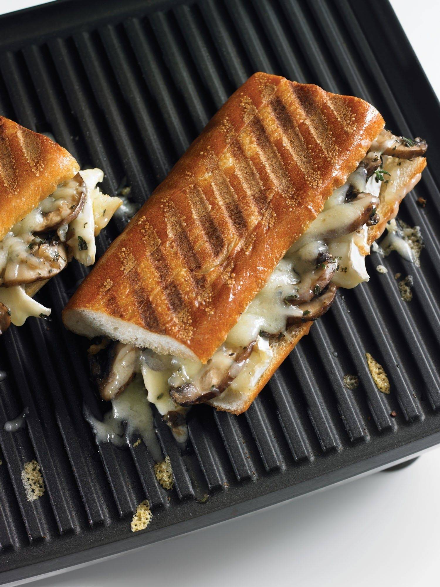 Mushrooms, Camembert and French Comte turn a humble grilled-cheese sandwich into company supper.