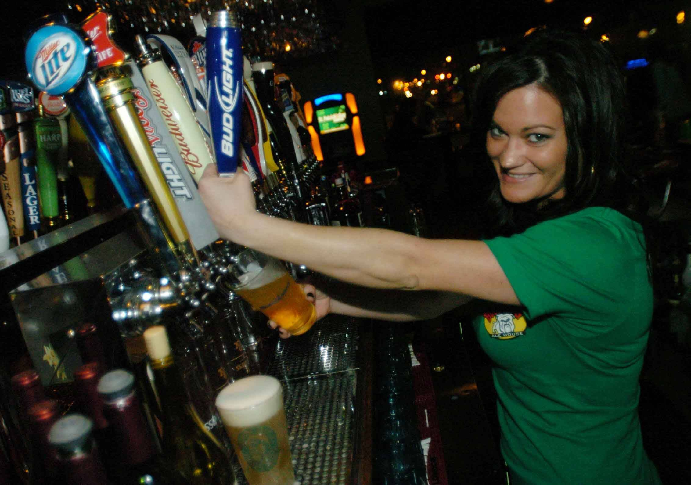 Jamie Ricke Taps A Beer At Bulldog Ale House In Carol Stream.