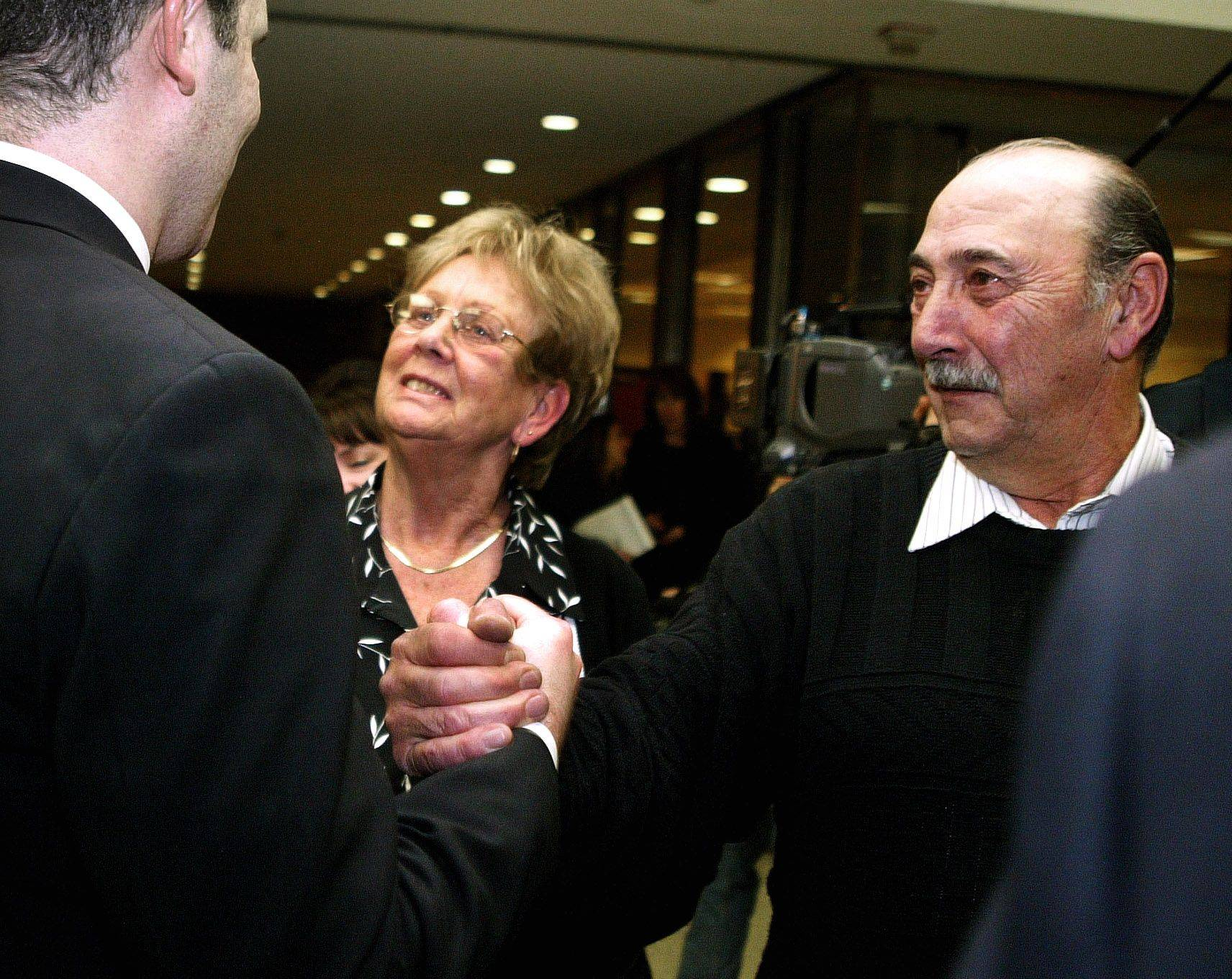 Rhoni Reuter's parents Landa, center, and Doug thank state's attorney Ari Fisz after Marni Yang was found guilty Tuesday in the murder of Rhoni Reuter.