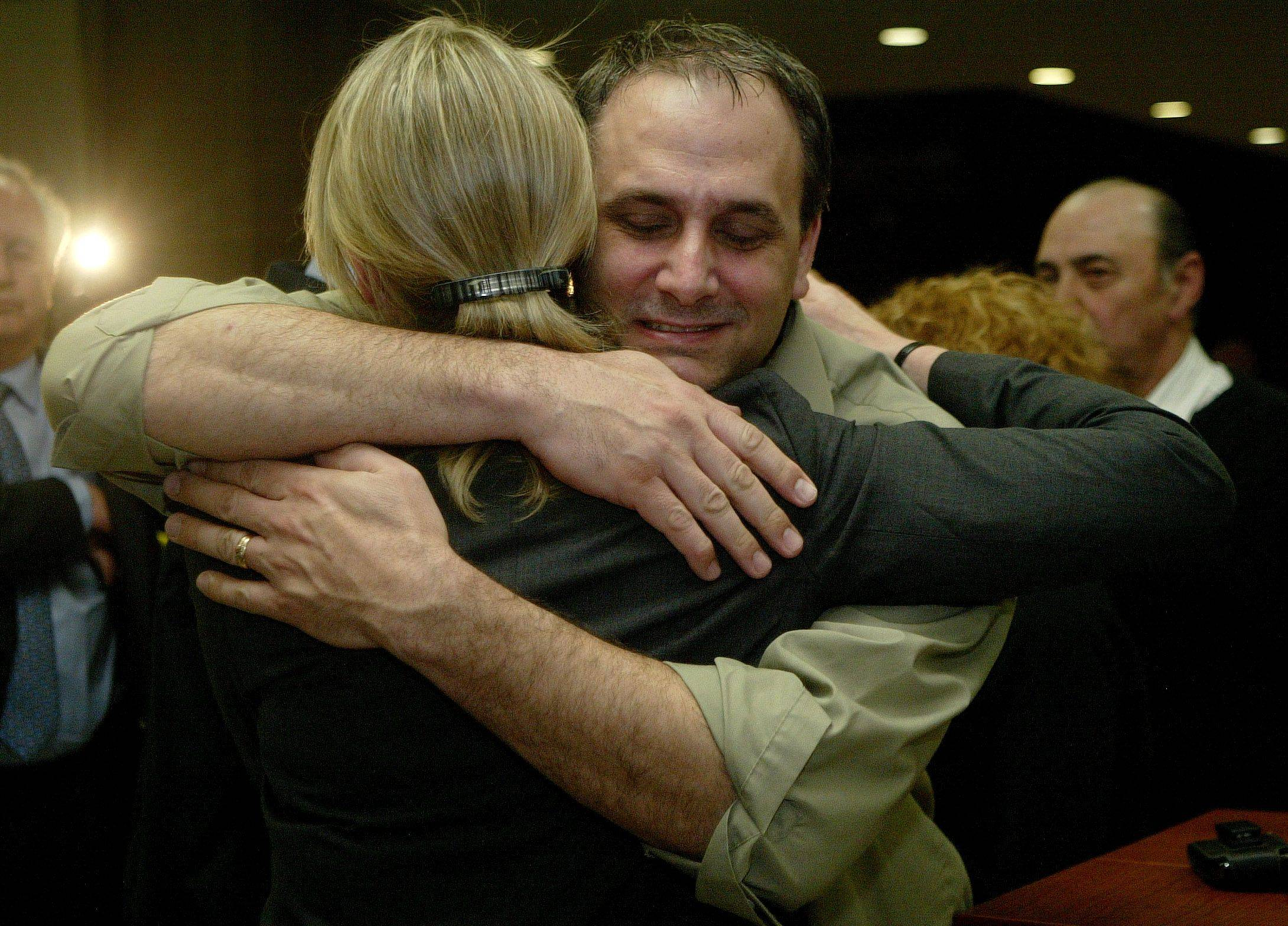 Thad Reuter, brother of murder victim Rhoni Reuter, hugs prosecuting attorney Patricia Fix after a guilty verdict was handed down Tuesday in the Marni Yang trial.