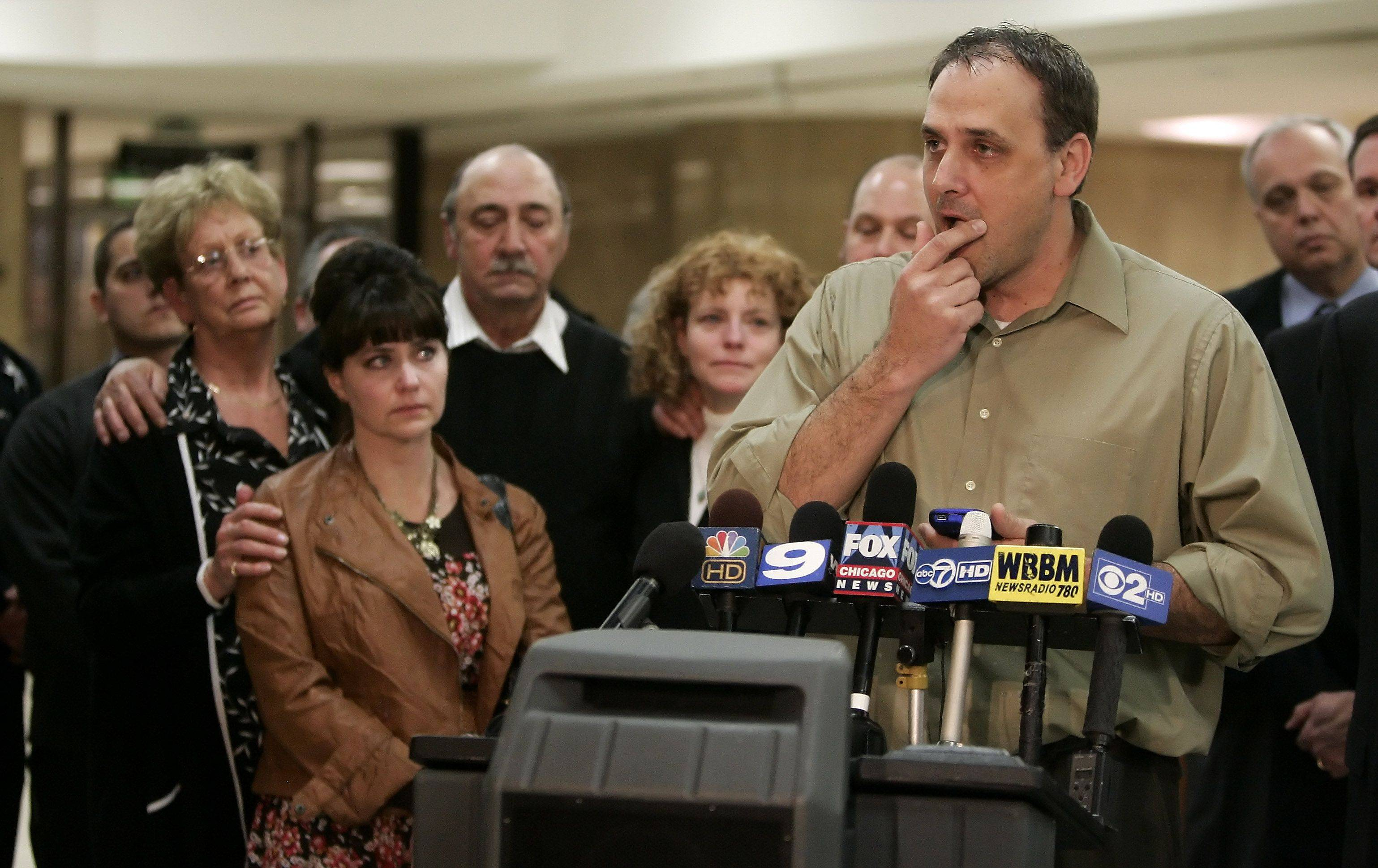 Gilbert R. Boucher II/gboucher@dailyherald.comThad Reuter, brother of Rhoni Reuter, right, is near tears as he addresses the media after the guilty verdict in the Marni Yang trial in the murder of Rhoni Reuter Tuesday at the Lake County courthouse in Waukegan. The rest of the Reuter family listens in the background.
