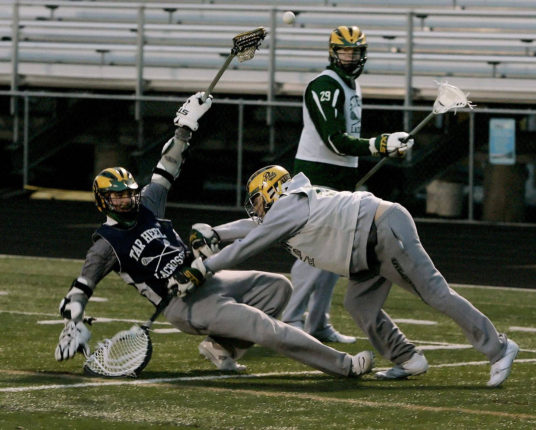 Goalkeeper Max Huber knocks down Sam Caruso during the boys lacrosse team practice at Stevenson High School in Lincolnshire.