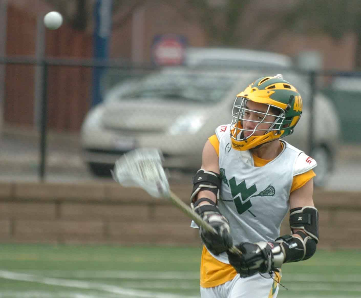 Brett Erwin of the Waubonsie/Metea Lacrosse team practices shooting drills at Aurora University.