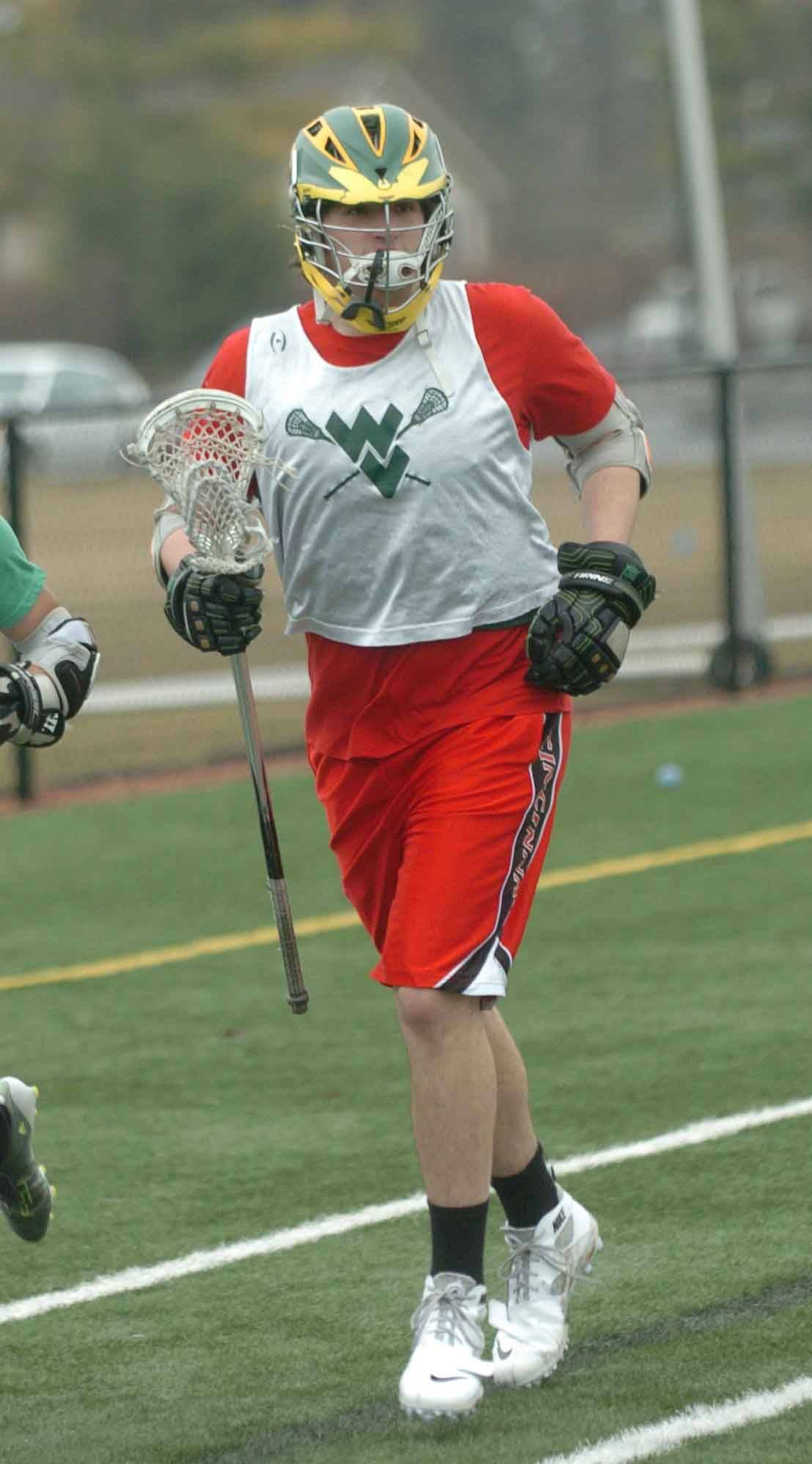 Zach Wood of the Waubonsie/Metea Lacrosse team takes part in practice at Aurora University.