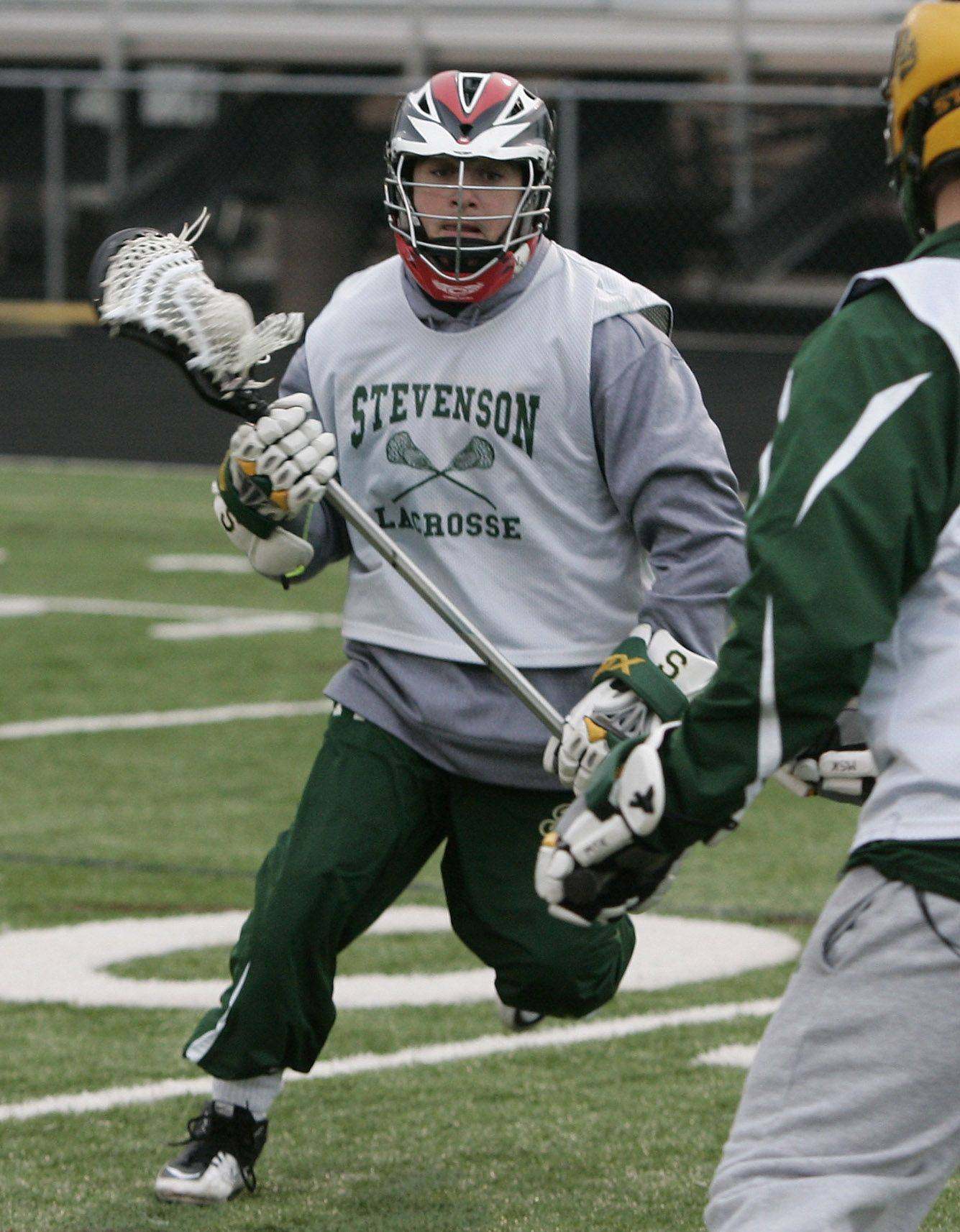 Attacker Adam Cook moves around a defender during the boys lacrosse team practice at Stevenson High School in Lincolnshire.