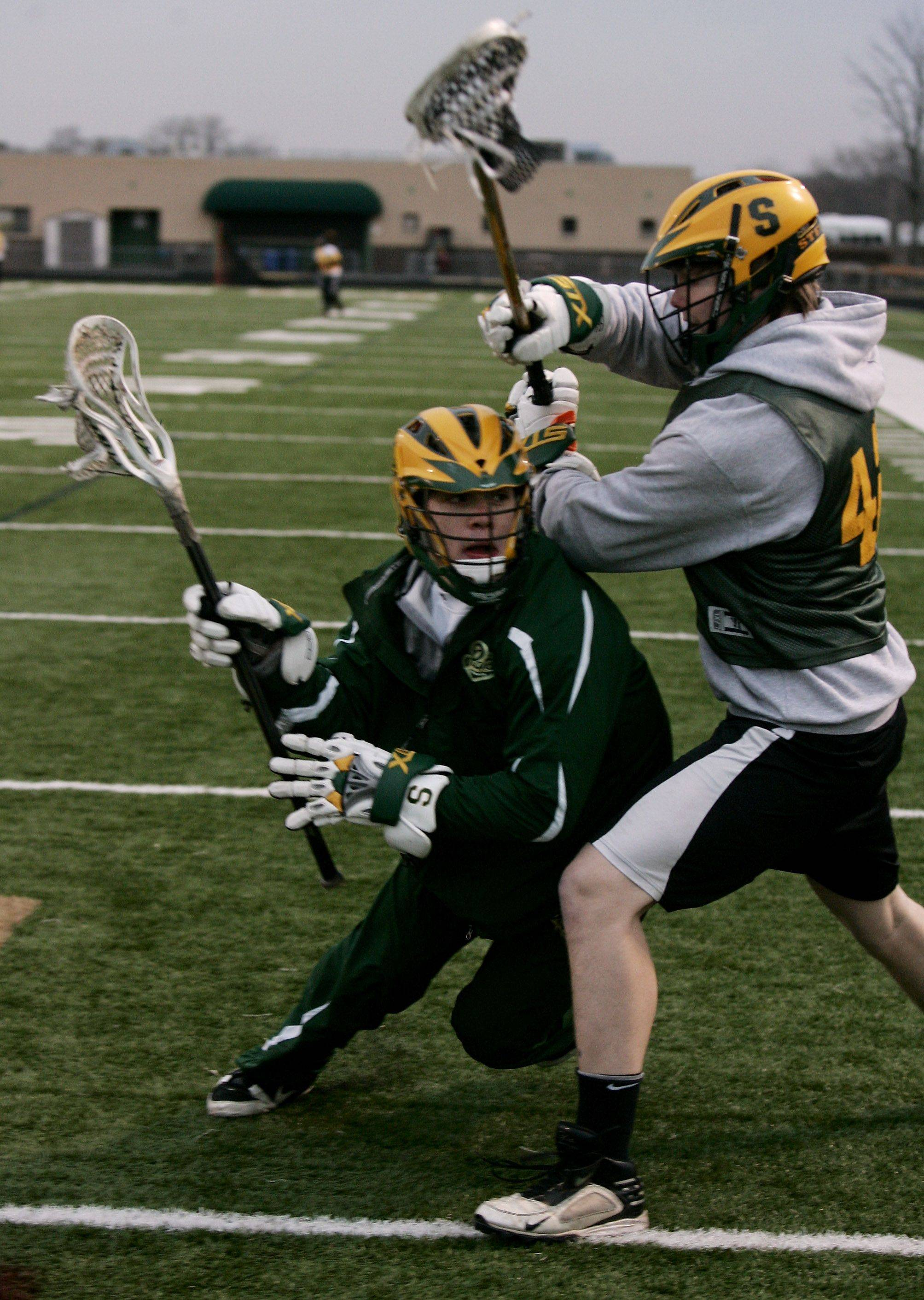 Midfielder Ryan Spitzer, left moves around defender Eric Brasier during the boys lacrosse team practice at Stevenson High School in Lincolnshire.