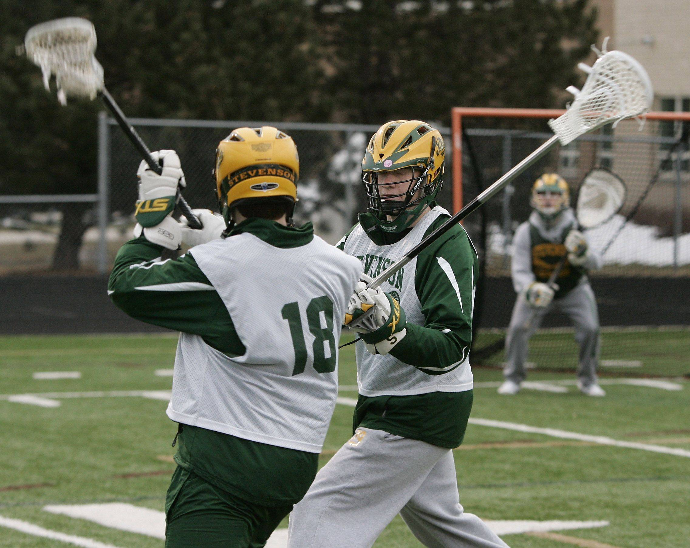Defender Matt Stritof blocks aa attacker during the boys lacrosse team practice at Stevenson High School in Lincolnshire.