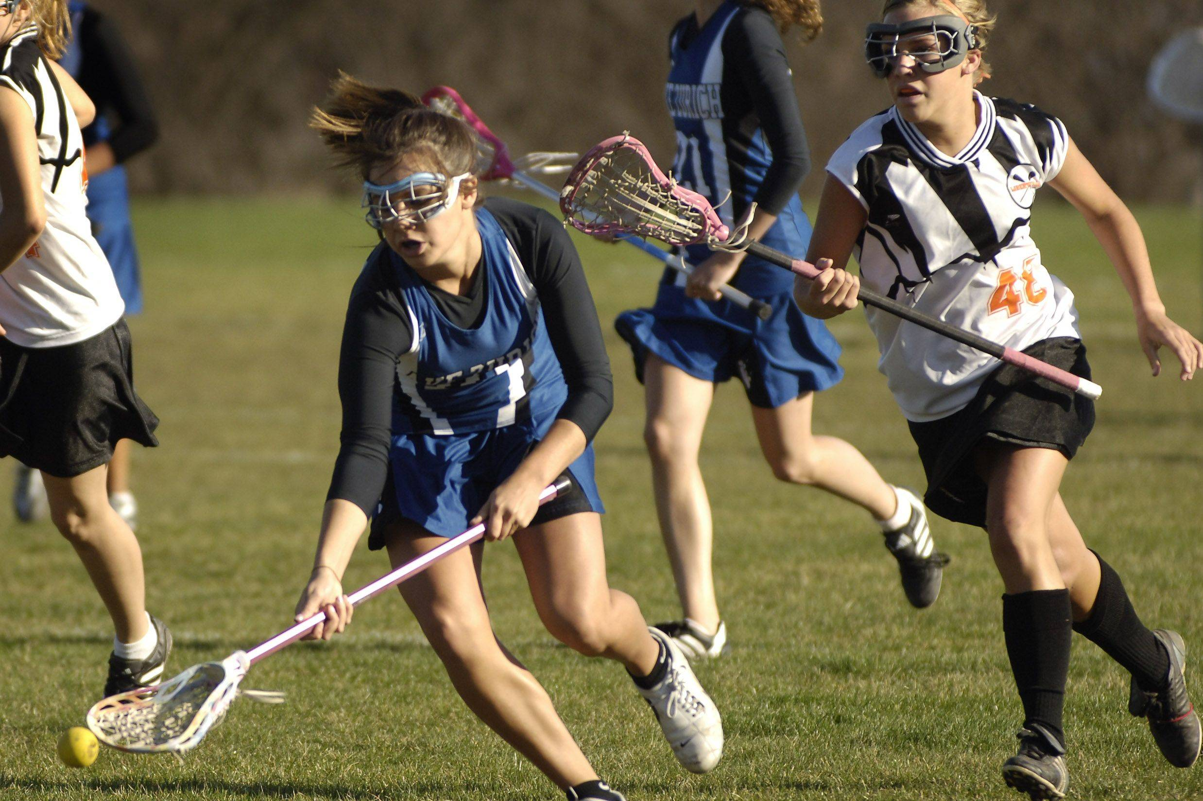 Lake Zurich and Libertyville are among the state's improving girls lacrosse programs, but both will be hard-pressed to crack the dominance of programs like defending champion Loyola and New Trier.