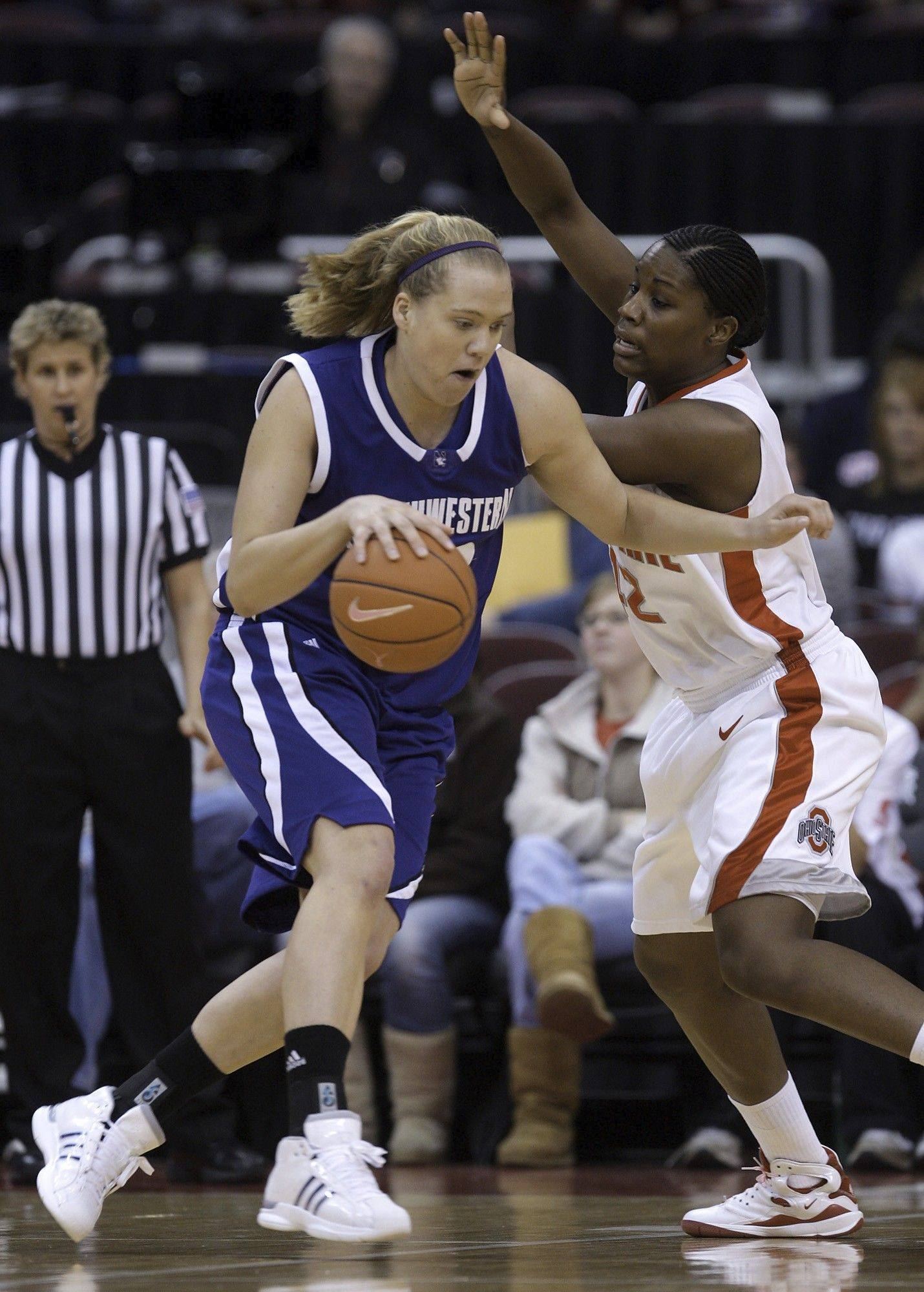 Northwestern's Amy Jaeschke, left, tries to dribble around Ohio State's Jantel Lavender during the first half of an NCAA college basketball game Sunday, Feb. 15, 2009, in Columbus, Ohio.