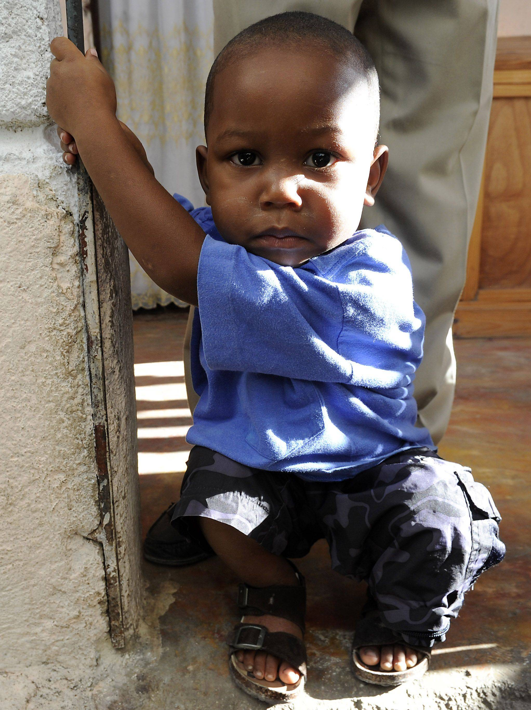 Godson, his given name Richardson Georges, 3, was pulled from the earthquake rubble after three days by Gesnel Augustine, 26, in Jacmel, Haiti. Augustine is now his father.