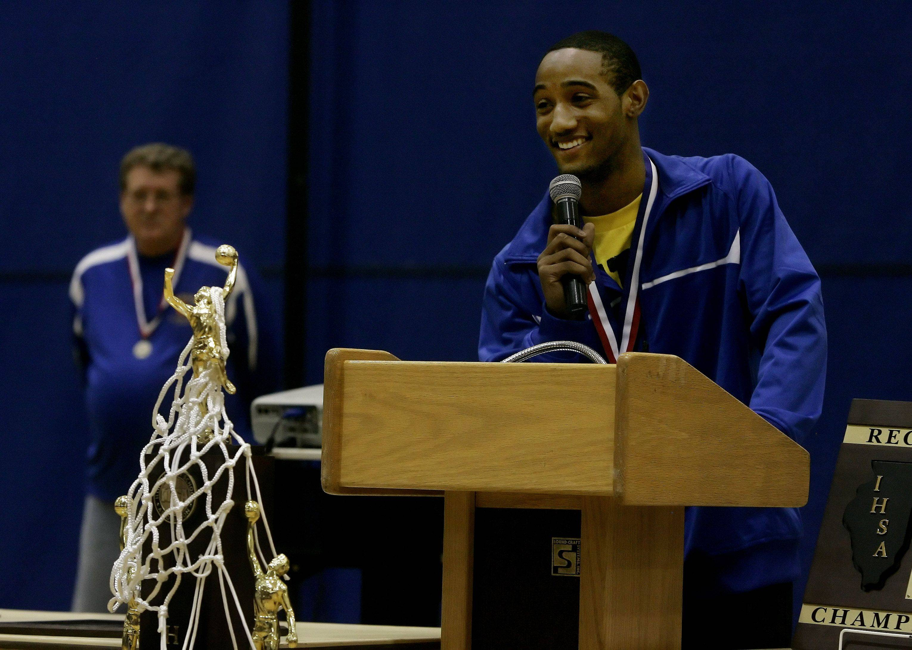 Basketball player Jameris Smith thanks the fans as the Warren Township High School boys basketball team returns to the school in Gurnee Sunday for a pep rally. Warren coach Chuck Ramsey stands in the back.