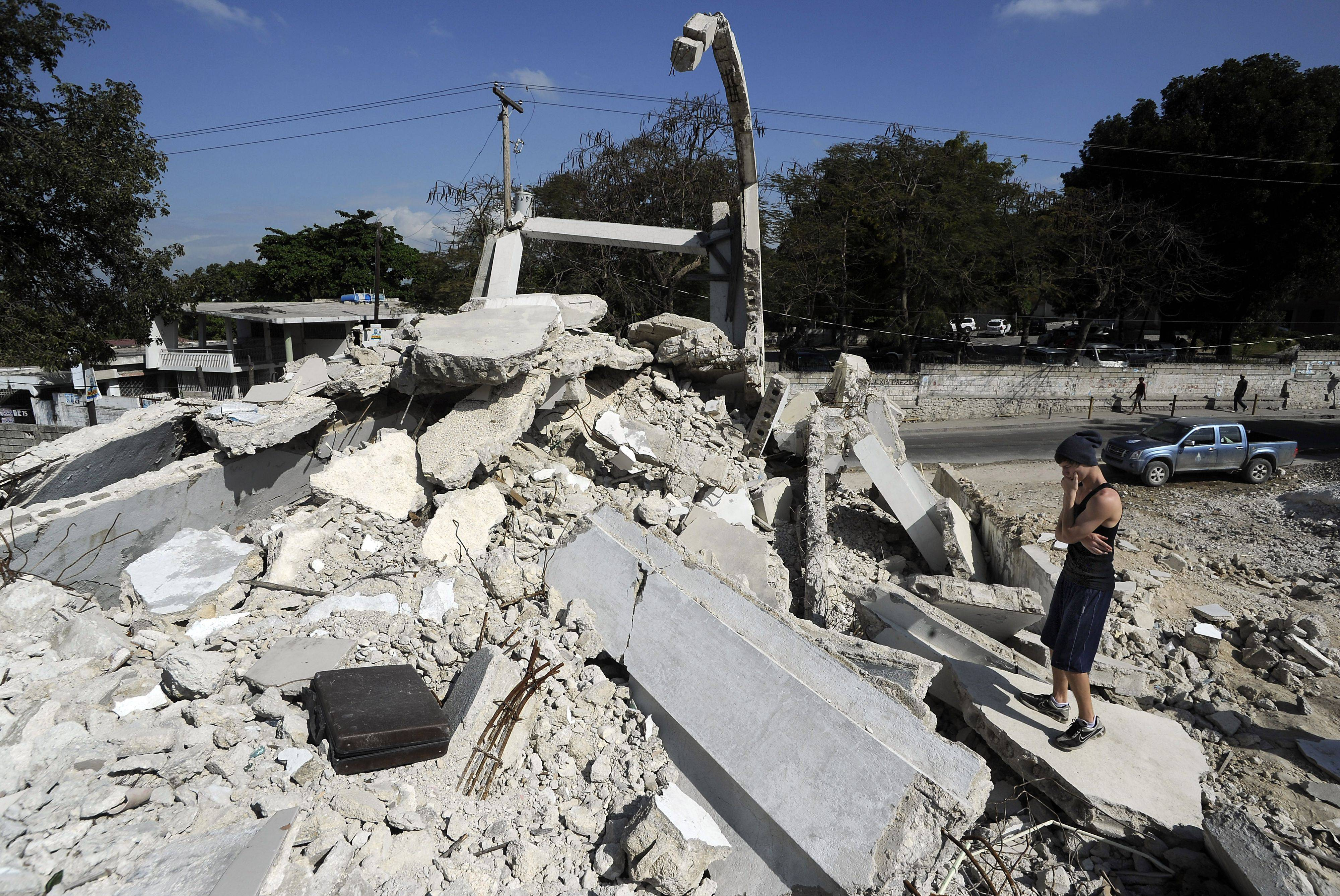 Josiah Ballantine, 18, of Elk Grove Village ponders the fate of five students still entombed under rubble at the university school in Port-au-Prince.