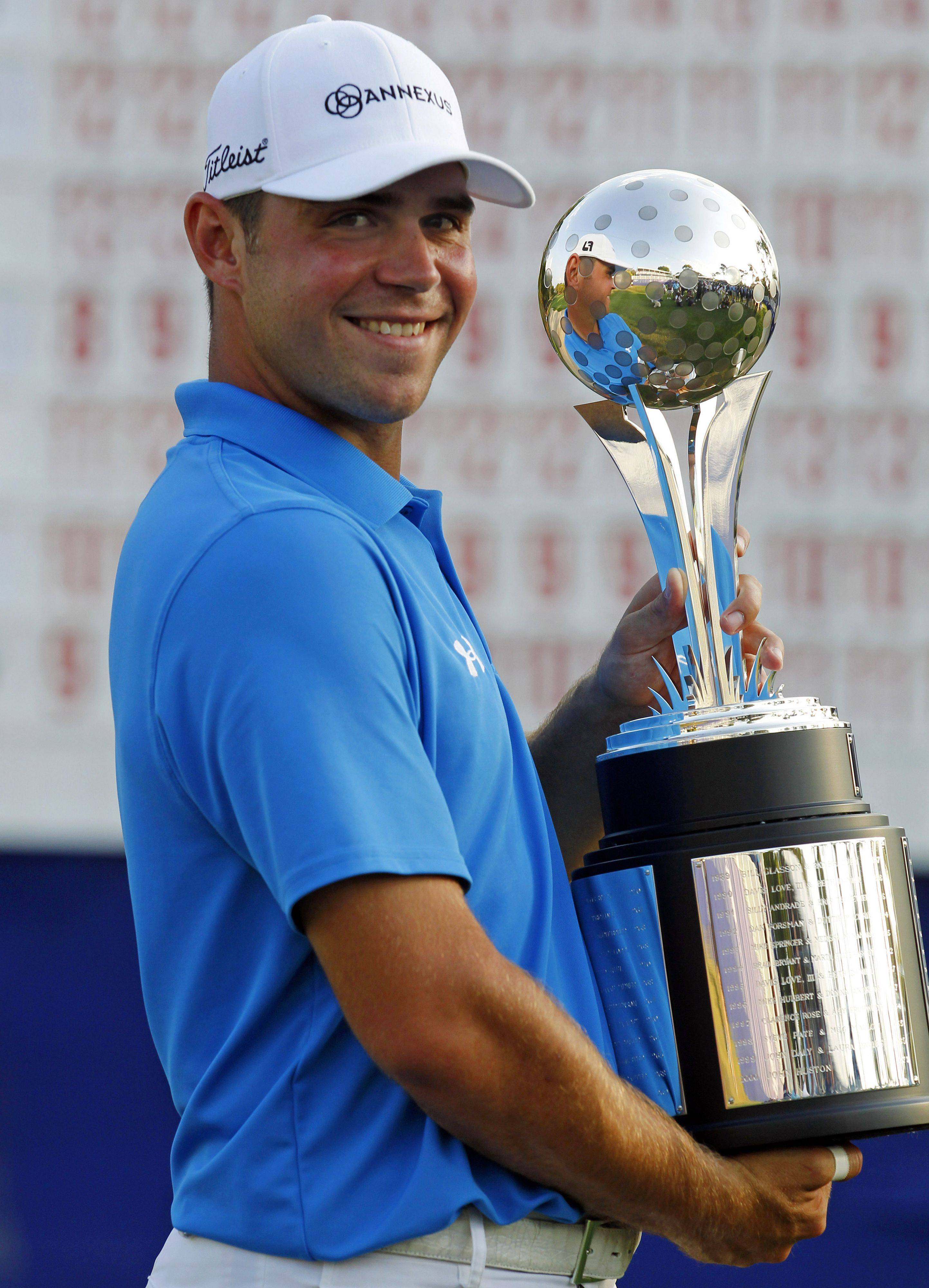 Gary Woodland celebrates with his trophy after winning the Transitions Championship on Sunday in Palm Harbor, Fla.