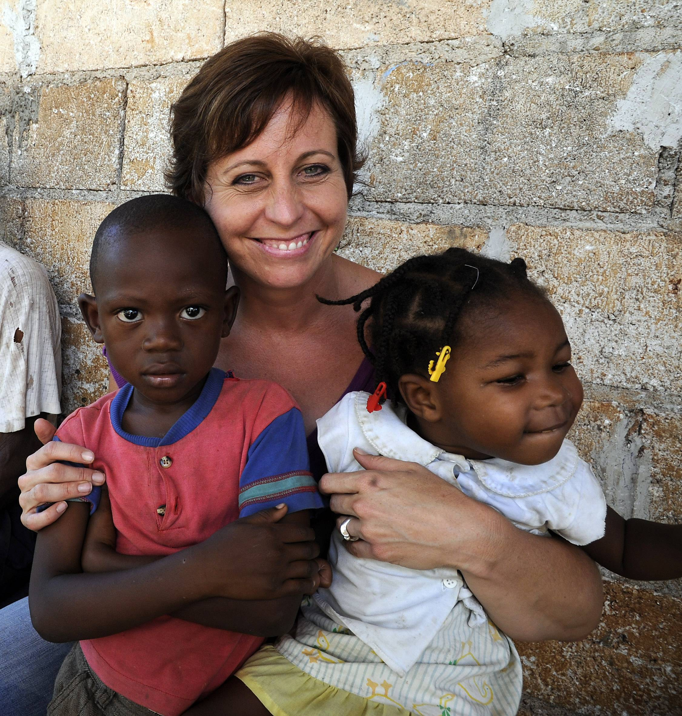 Lisa Ballantine, Director of FilterPure Filters with kids in Jacmel, Haiti.