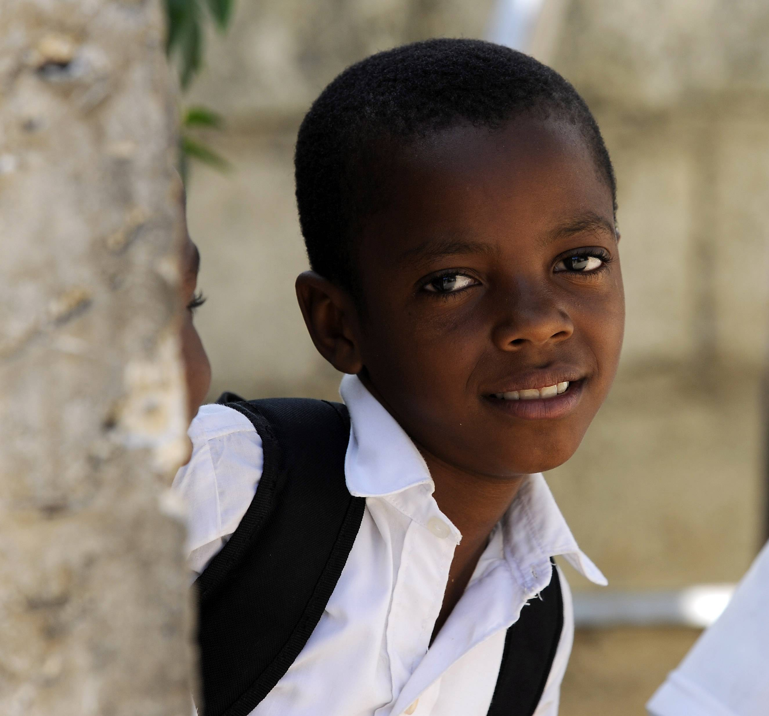 A young schoolboy walks home after school in Jacmel, Haiti.