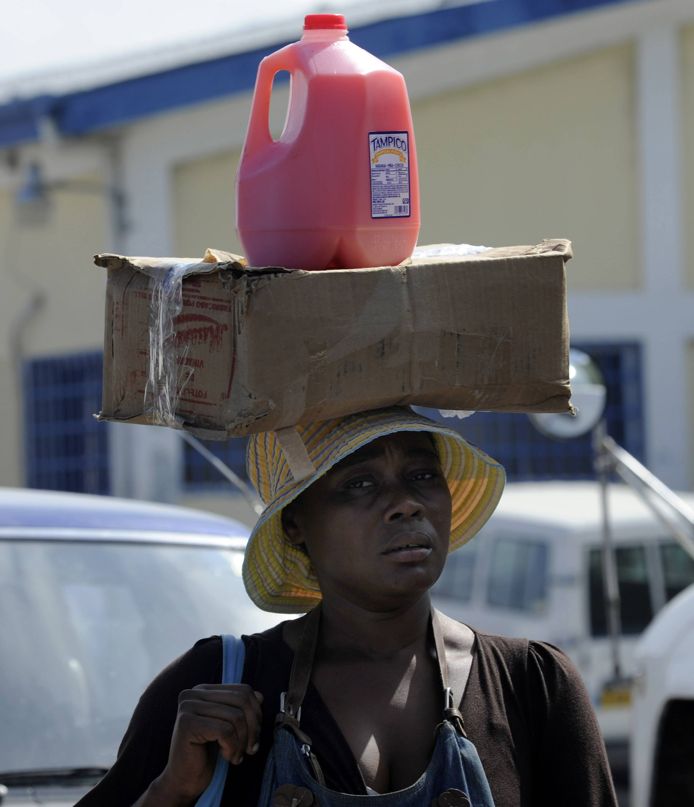 A Haitian woman carries her supplies on market day at the border between the Dominican Republic and Haiti.