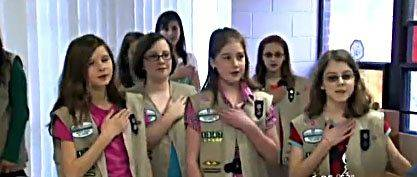 The members of Troop 1347 in Cary recite the Girl Scout Promise on Monday.