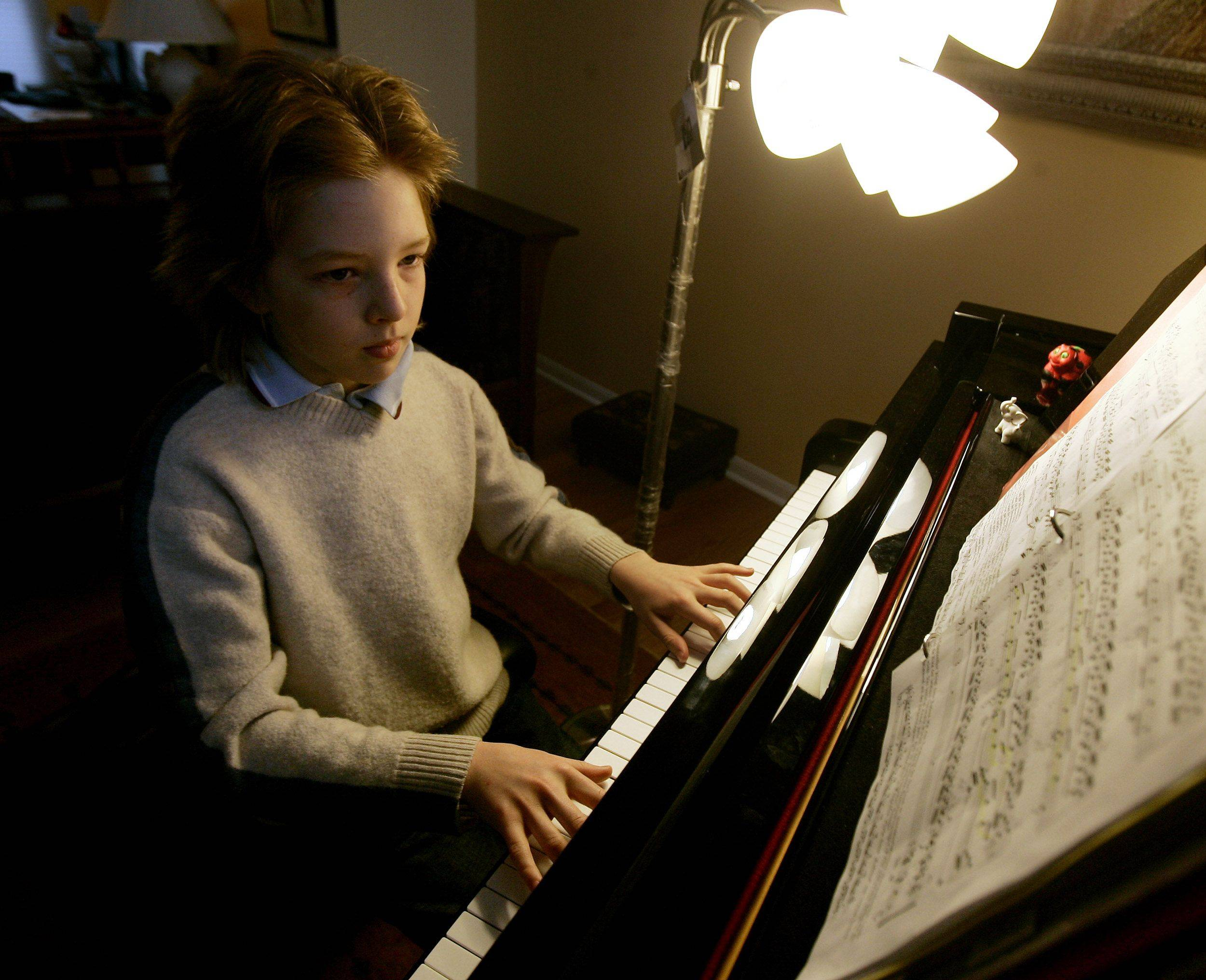 "Gifted student Antony Simonoff practices on the piano at his home in Vernon Hills. Antony recently performed in the Joffrey Ballet production of ""The Nutcracker."""