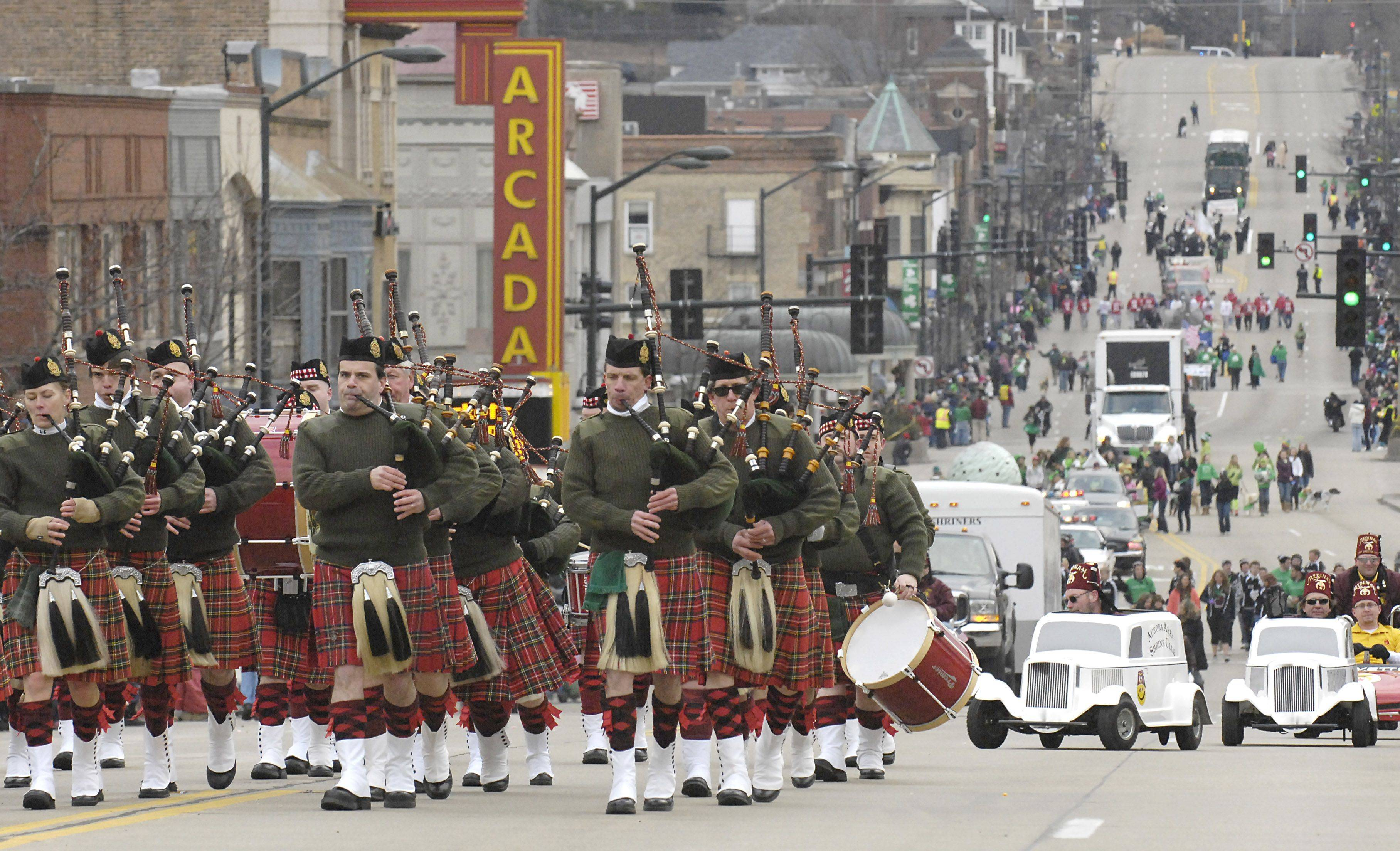 The Chicago Highlanders Pipes & Drum Band head east on Main Street through downtown St. Charles in the St. Patrick's Day parade on Saturday, March 13.