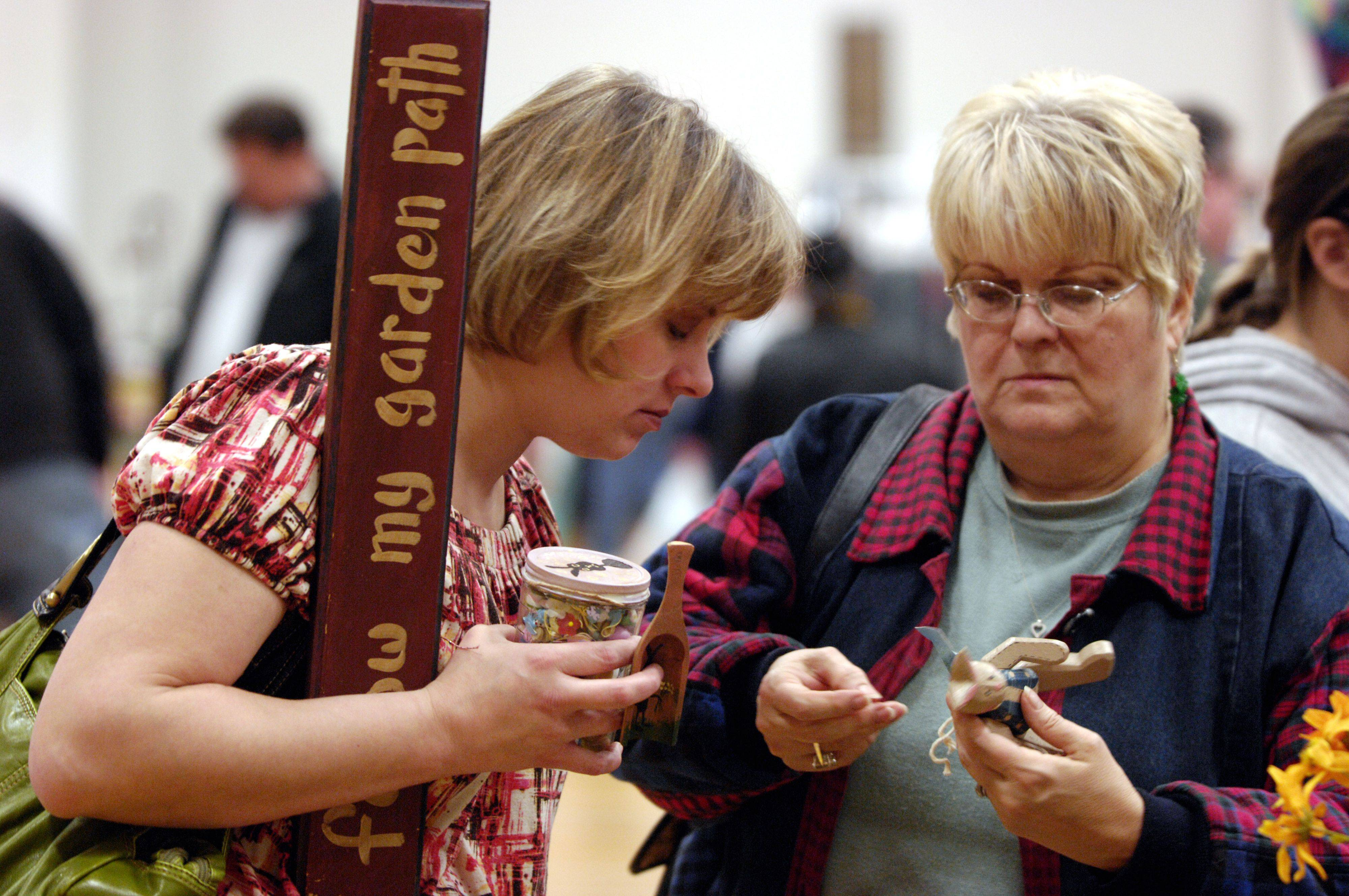 Sue Nieciecki of Schuamburg and her mother-in-law Judy Nieciecki of Prospect Heights look for deals at the 38th Collectibles, Craft and Flea Market at Elgin High School.
