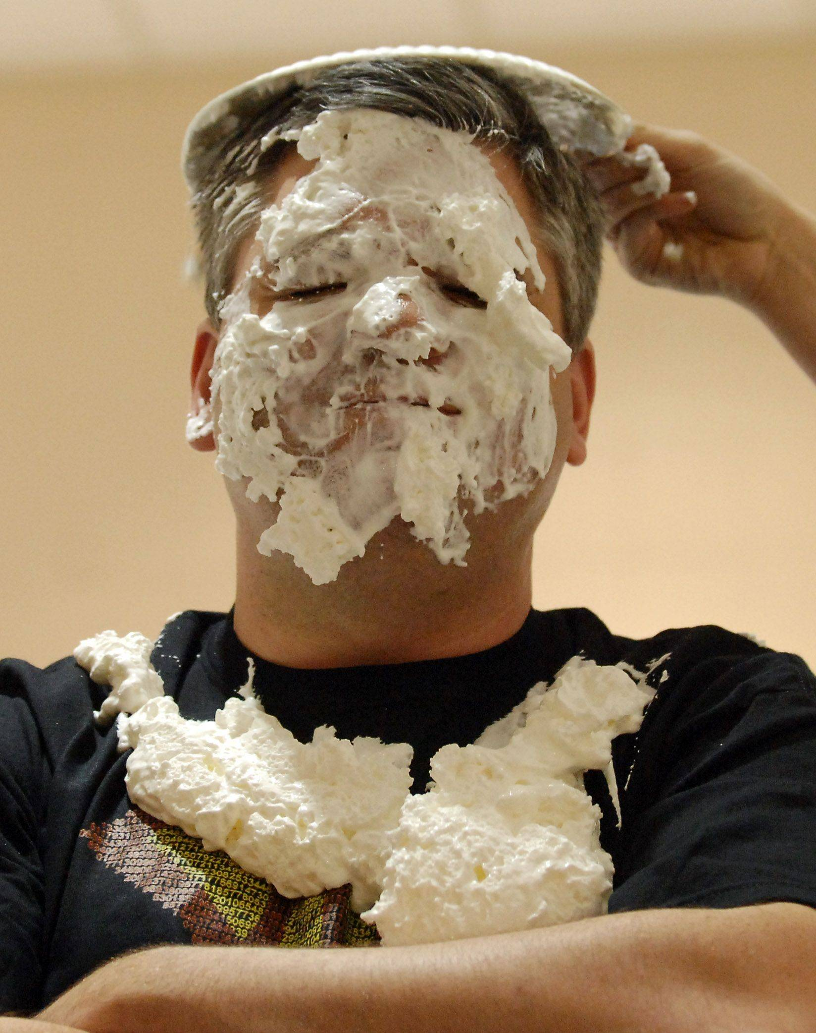 Geneva Middle School principal Terry Bleau suffers one final indignity as he gets a pie hat after taking most of it in the face from eighth-grade students who won the privilege by memorizing the most digits of Pi at the school Monday. The eighth-grade winners were Rachel Valiunas and Zane Shaw.