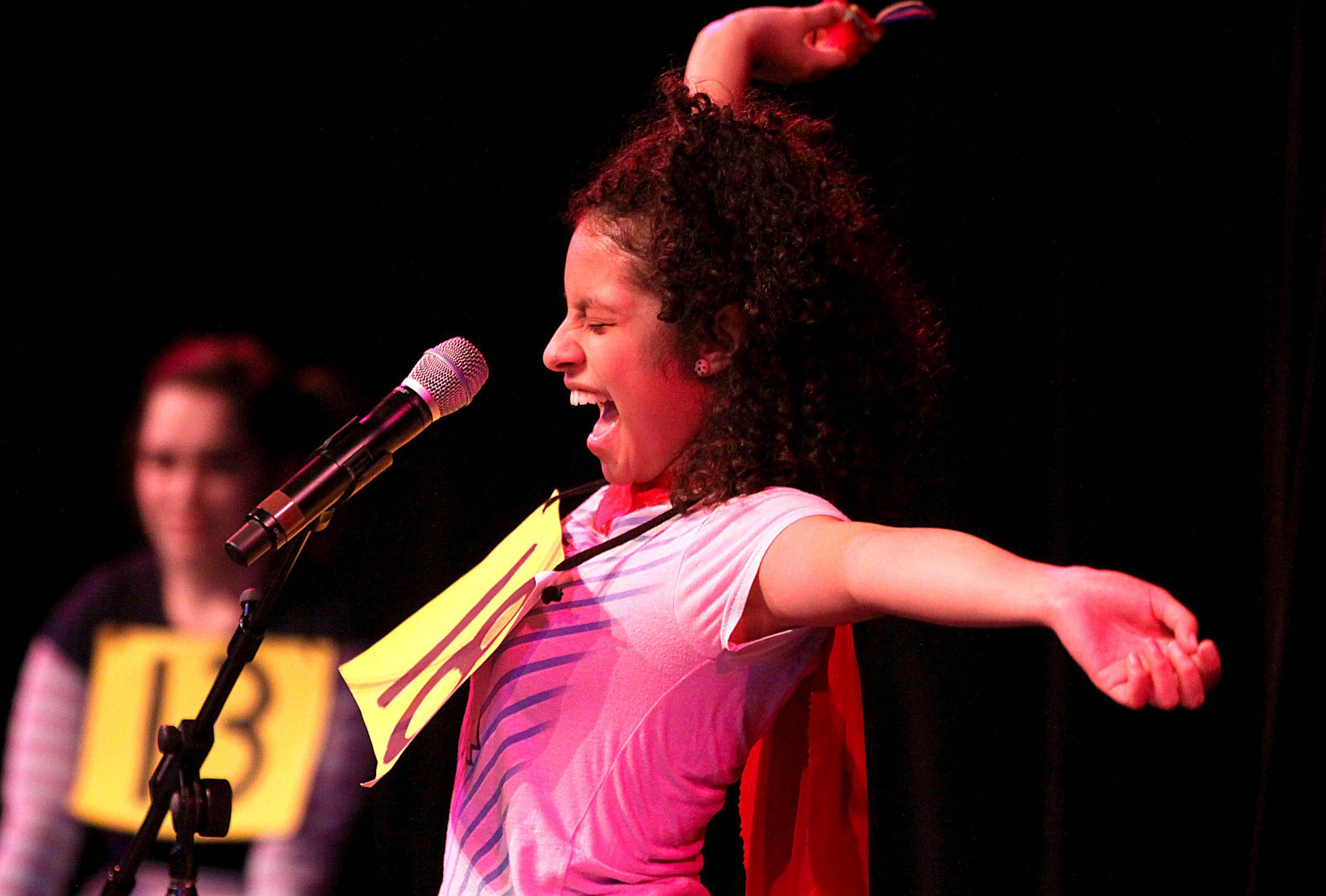 Paulina Nava of Larkin High School performs her dramatic vocal act as part of the Talent Fest Follow Your Star show at the Hemmens Cultural Center in Elgin on Tuesday night. Nava, accompanied by Clee McKracken, Katrina Syrris, and Maggie Koch, won first place in the competition.