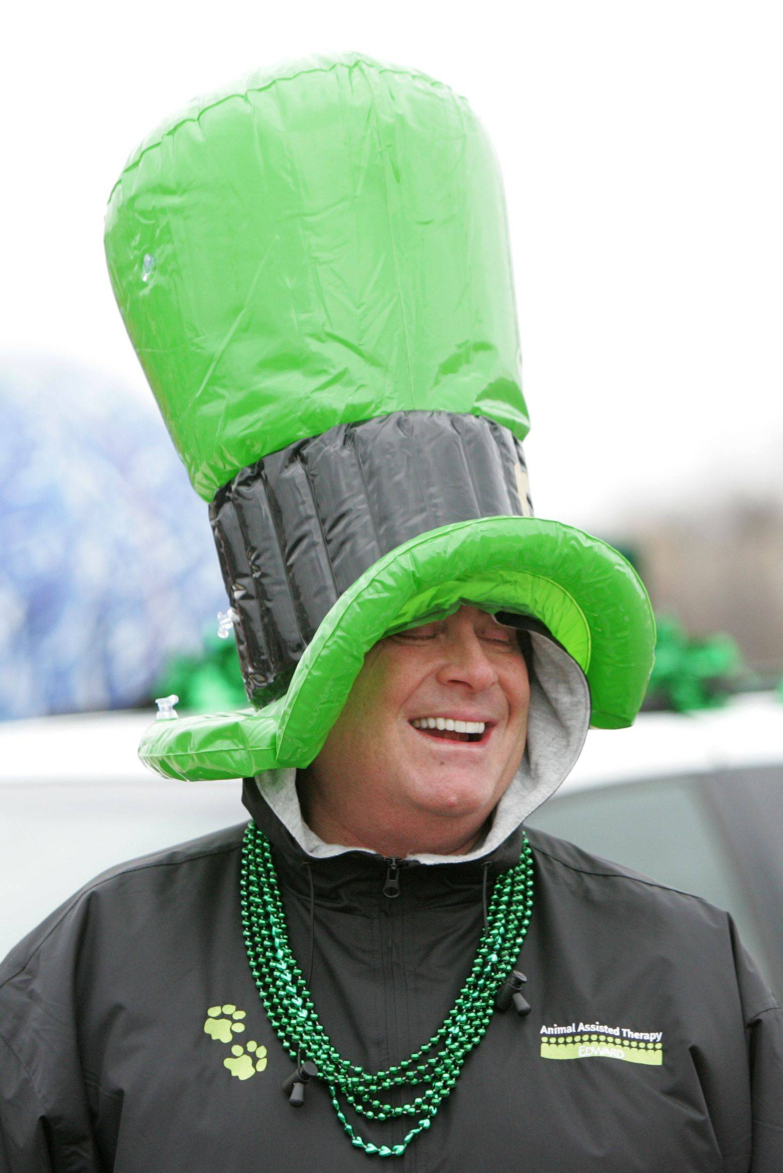 Scott Miller of Burr Ridge participates in the annual St. Patrick's Day Parade in downtown Naperville.