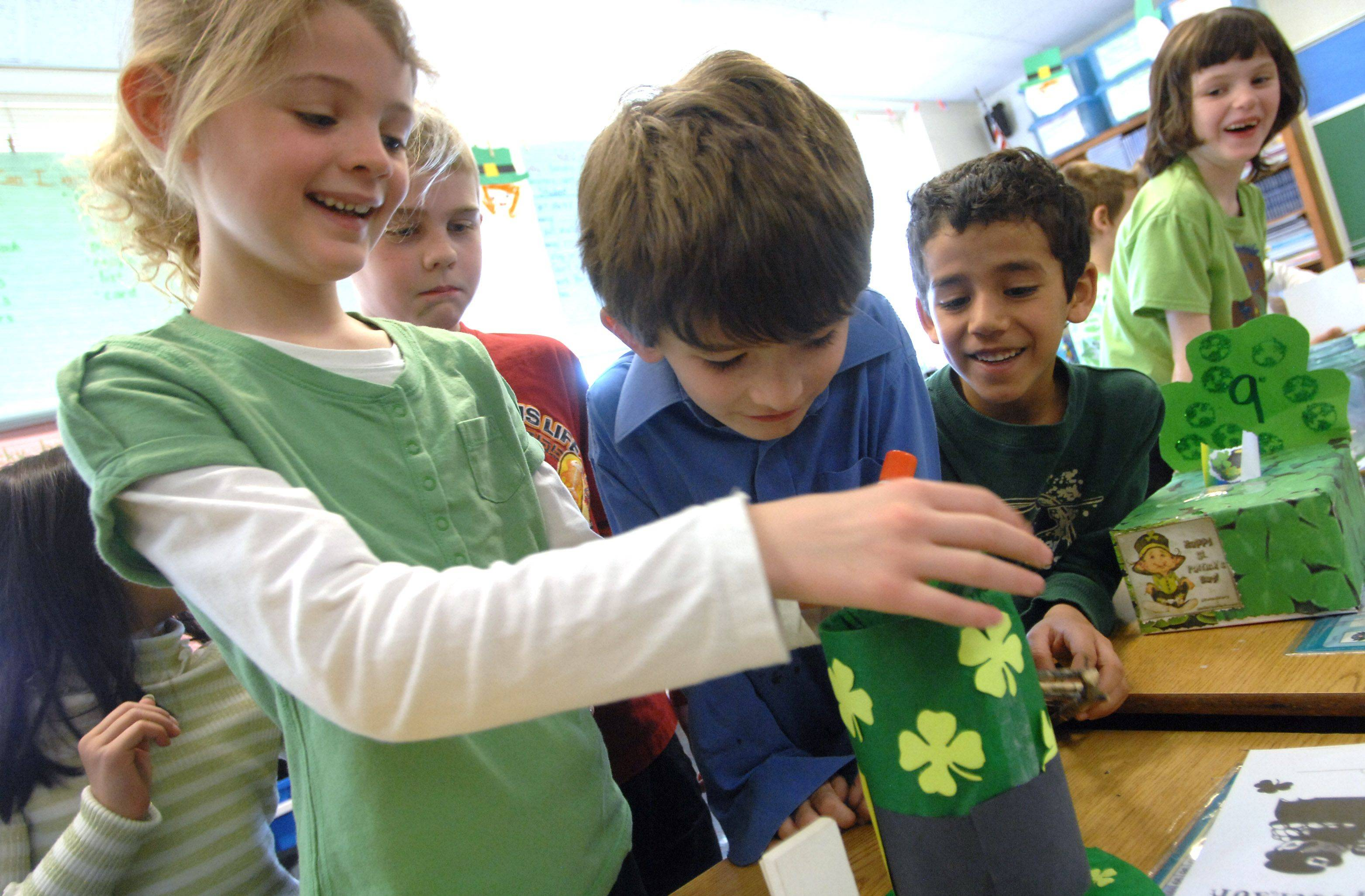 Adler Park School first-grade students show off leprechaun traps they made in celebration of St. Patrick's Day. First-grade student Kaeden Theobald, left, shows how her trap works for students Kyle Otte, left, Ian Earley Tono Carrera and Sarah Cowsky Wednesday in Libertyville.