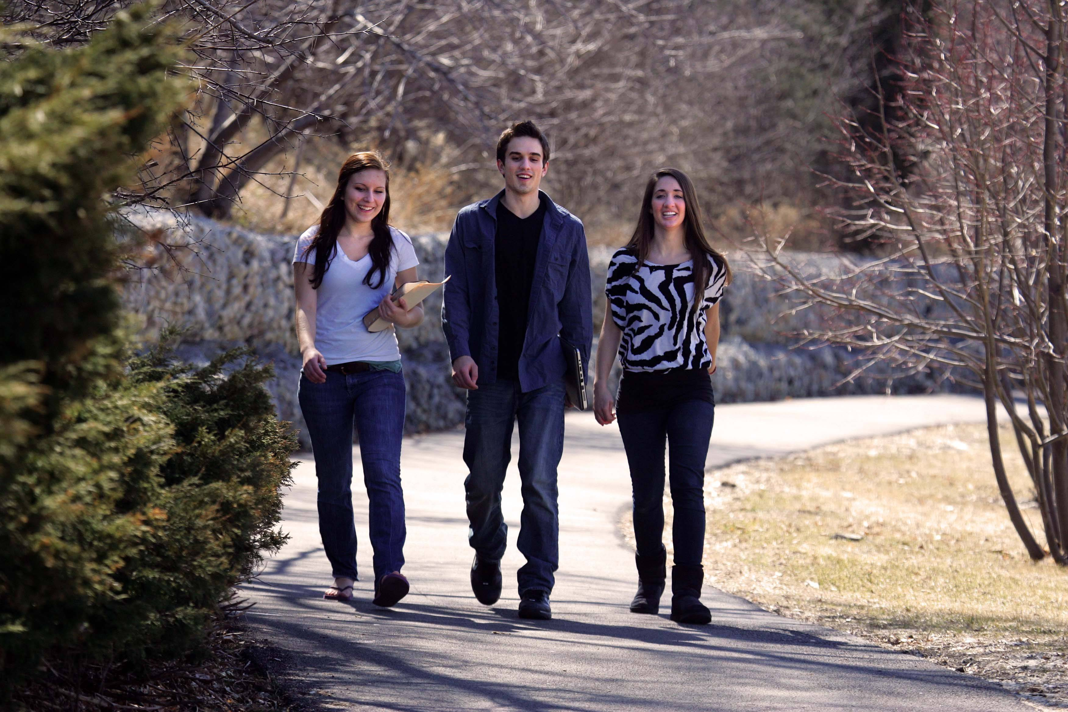 """This is the first time in forever that I have been able to walk anywhere without a coat,"" remarked Judson student Mike Nicosia, 20, as he walks to class with his friend Lauren Stengel, 19, right, and his sister Jessica Nicosia, 16, who were visiting Wednesday in Elgin."