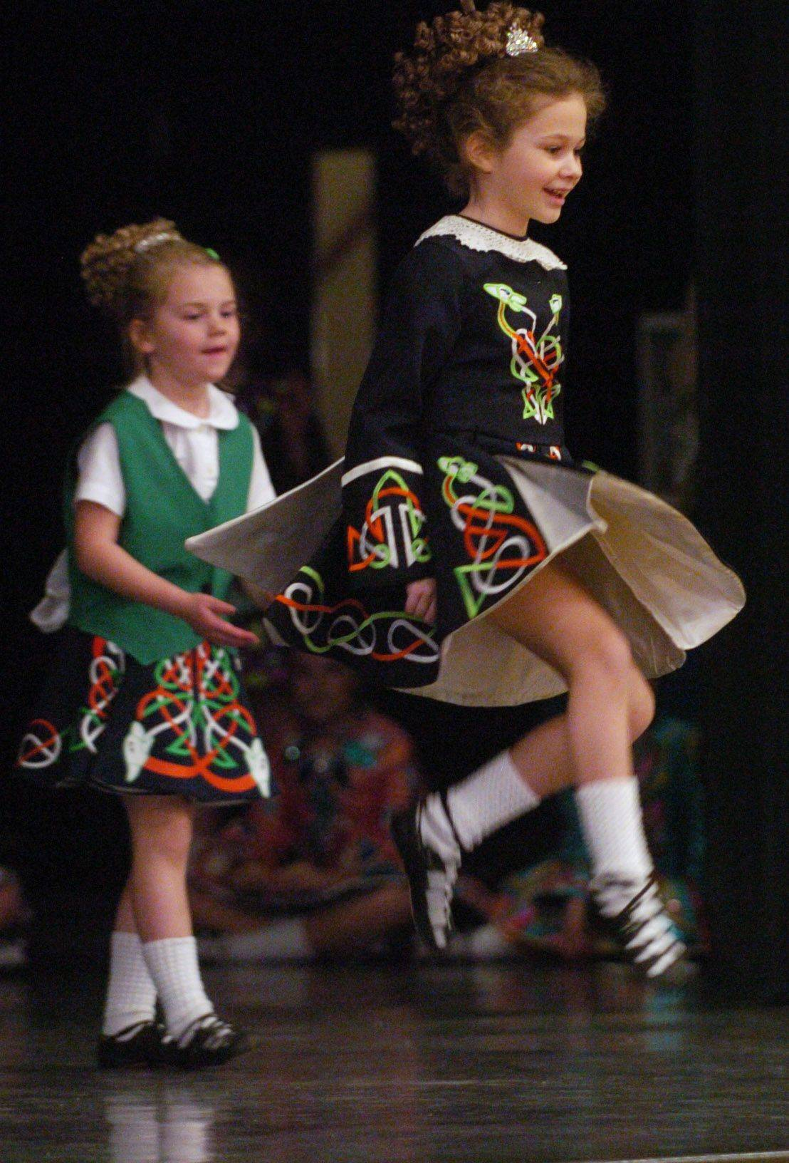 Bridgett O'Grady, 7, right, and Margaret Lennon, 6, both of Arlington Heights, perform with the Mullane-Healy-Godley School of Irish Dance at St. James School in Arlington Heights.