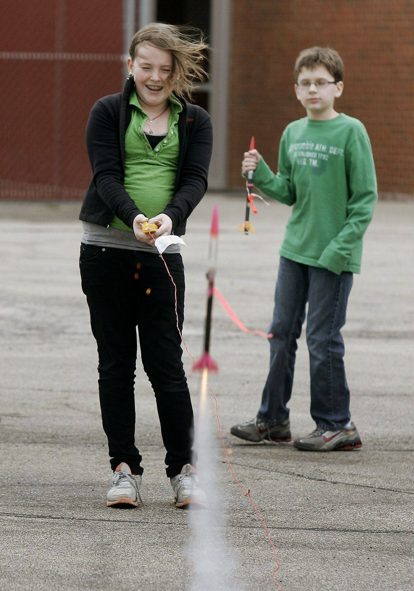 Abbie Sise, 11, left, fires the ignition as Andrew Hurley, 13, watches the rocket liftoff Thursday at Fremont Middle School in Mundelein.