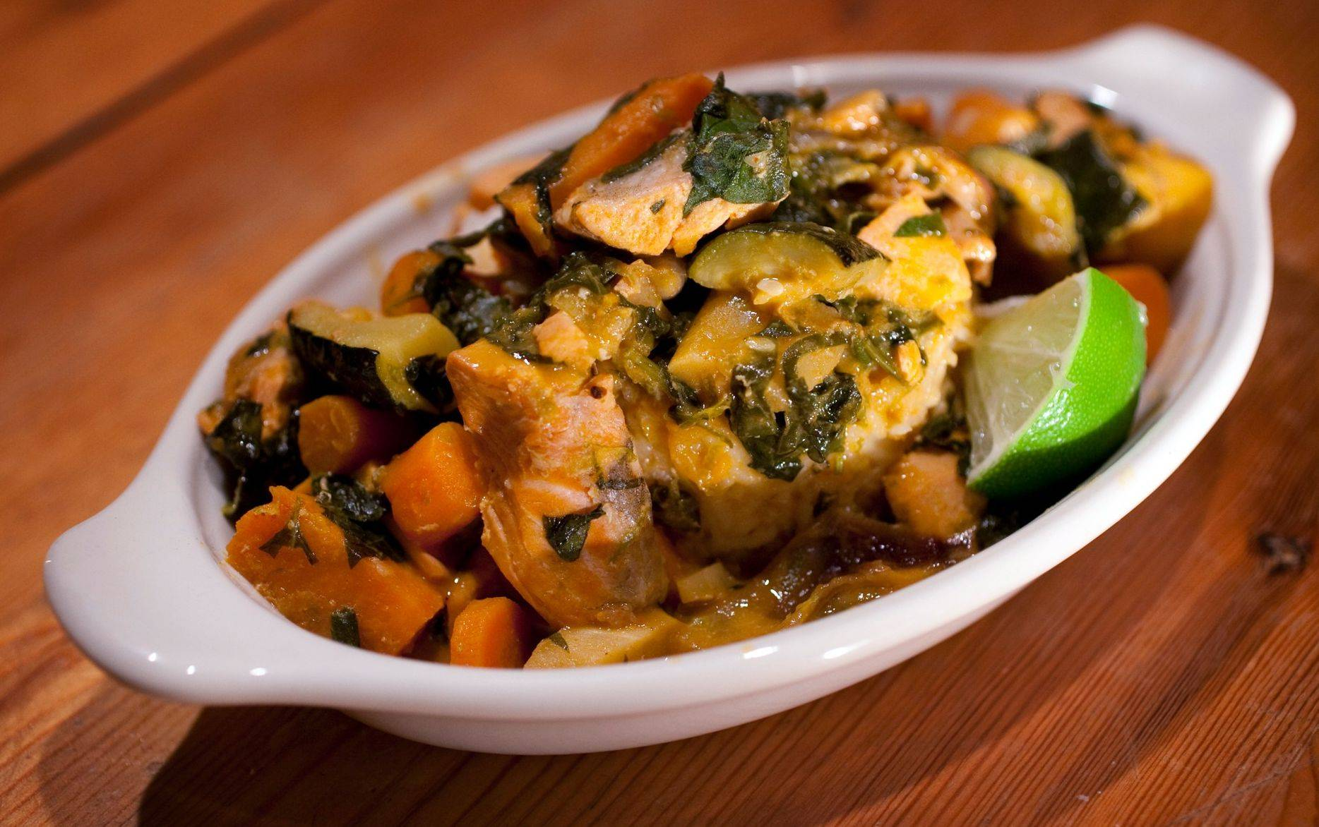 Thai Red Curry Salmon Stew starts with a batch of roasted vegetables and could just as easily be made with shrimp or chicken instead of salmon.