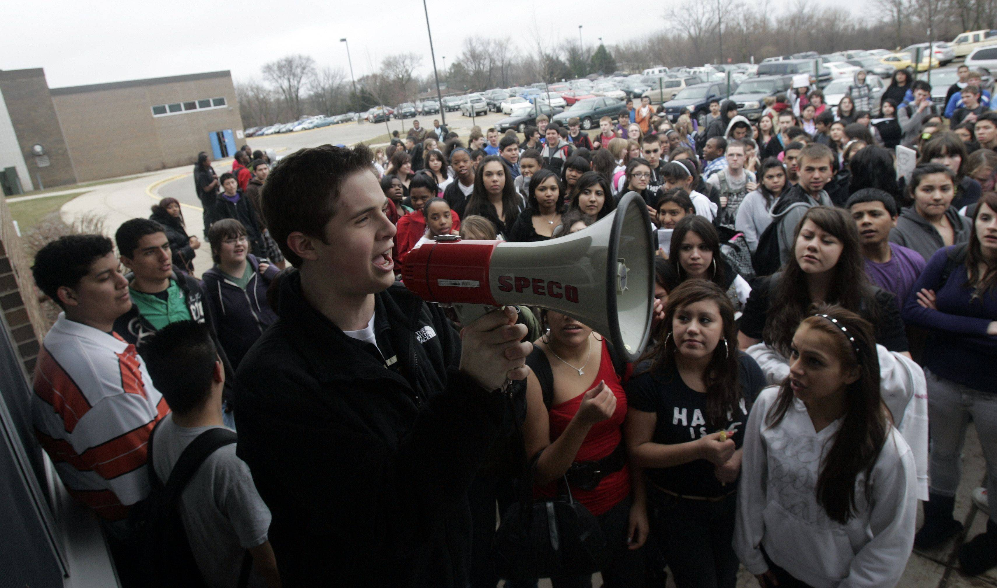 Brian Hill/bhill@dailyherald.com Seventeen-year-old Dundee-Crown student Mike Kelley rallies his fellow students as they stage a walkout in support of their teachers and administrators Tuesday, March 22, 2011 in Carpentersville.