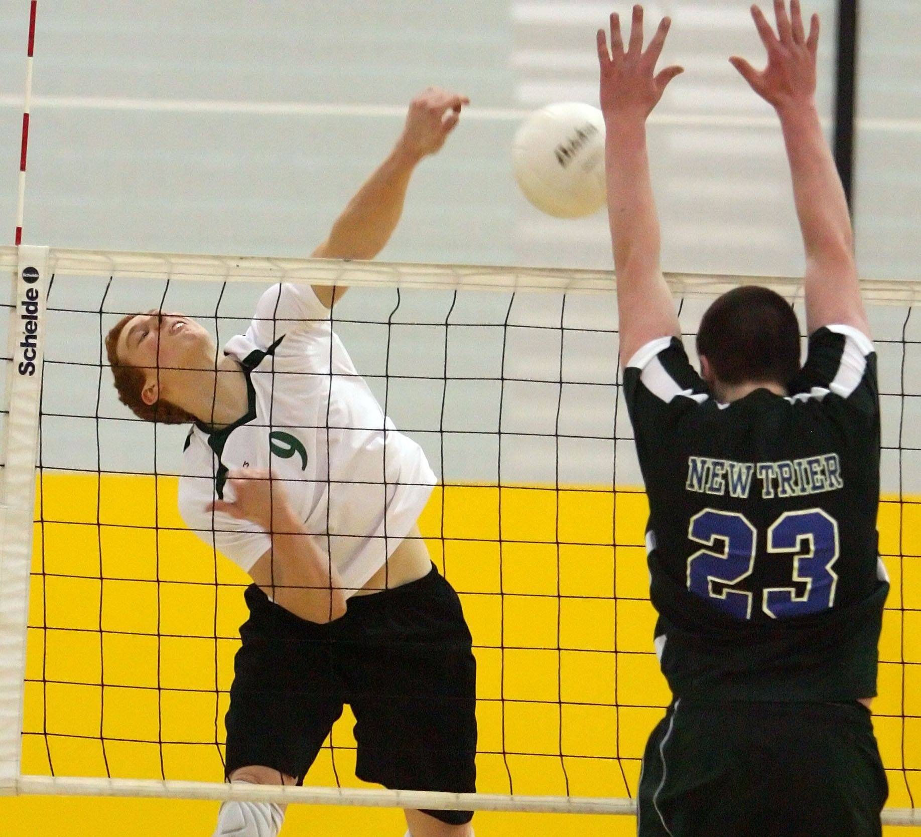 Stevenson's Jason Fleischman, left, spikes one at New Trier's Andy Gates on Tuesday night at Stevenson.