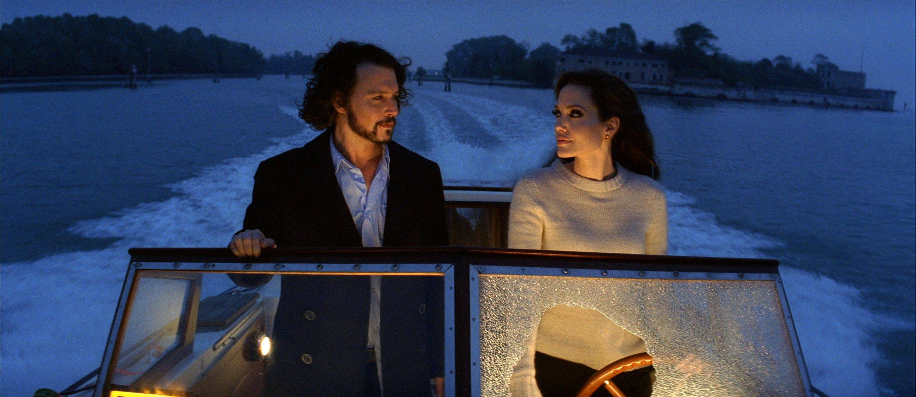 "Frank Tupelo (Johnny Depp) has his life turned upside down by a mysterious woman (Angelina Jolie) in ""The Tourist."""