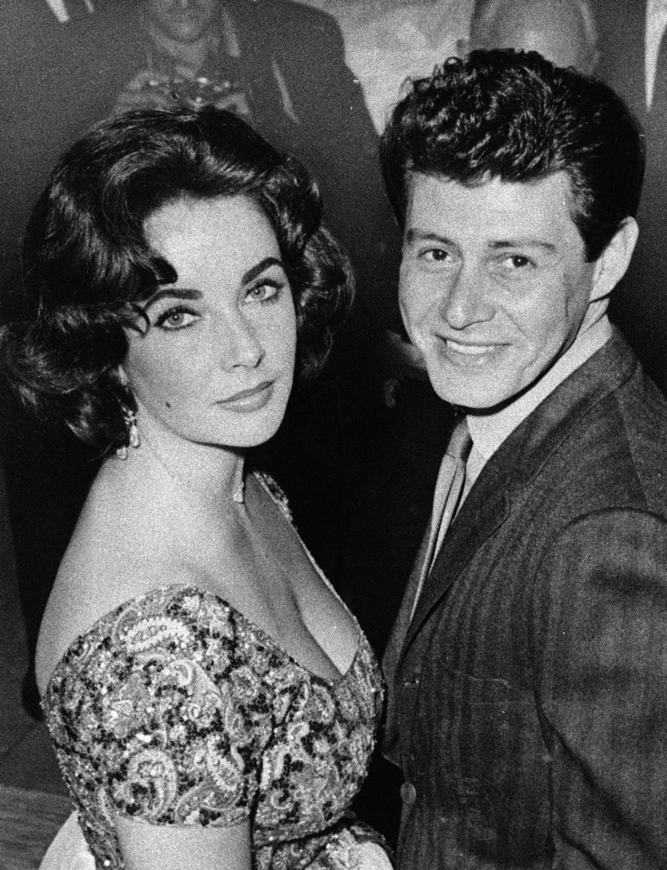 Actress Elizabeth Taylor is seen with singer Eddie Fisher before their marriage in 1959.